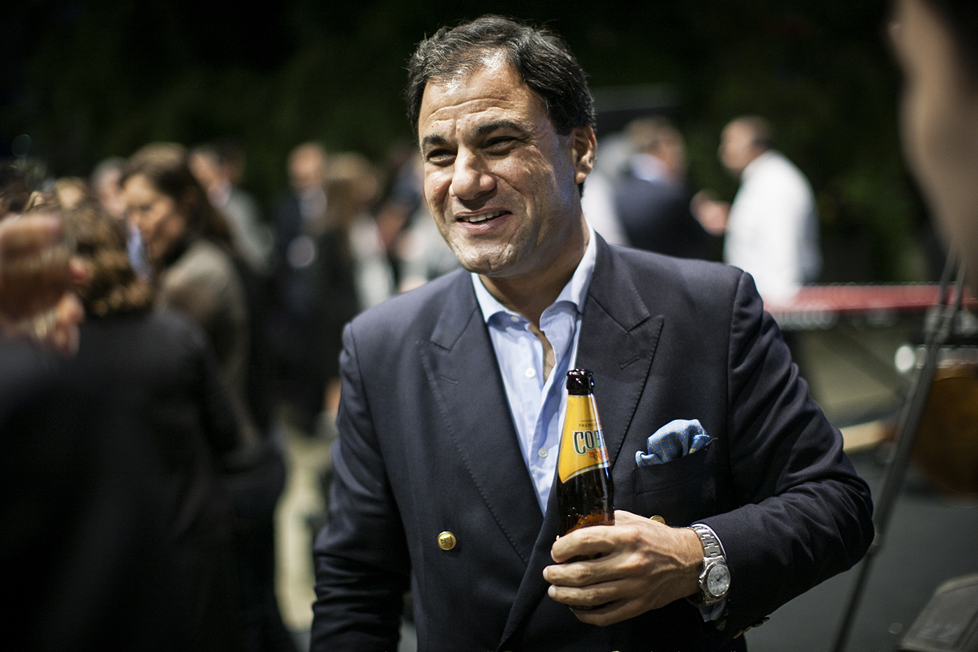 Lord Bilimoria, posing with a bottle of Cobra Beer.