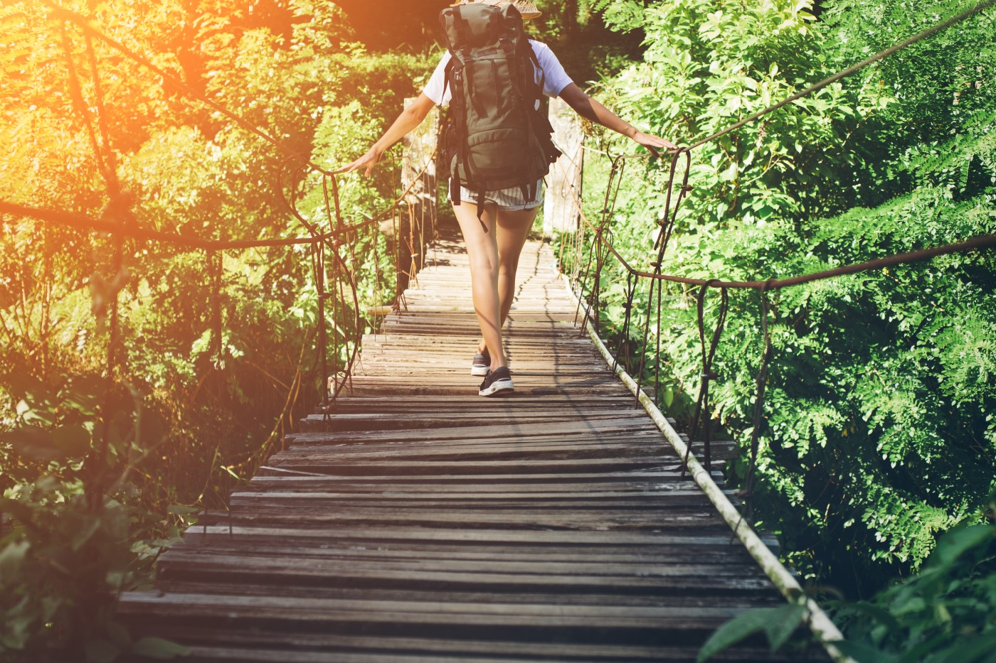 Traveller walking over bridge
