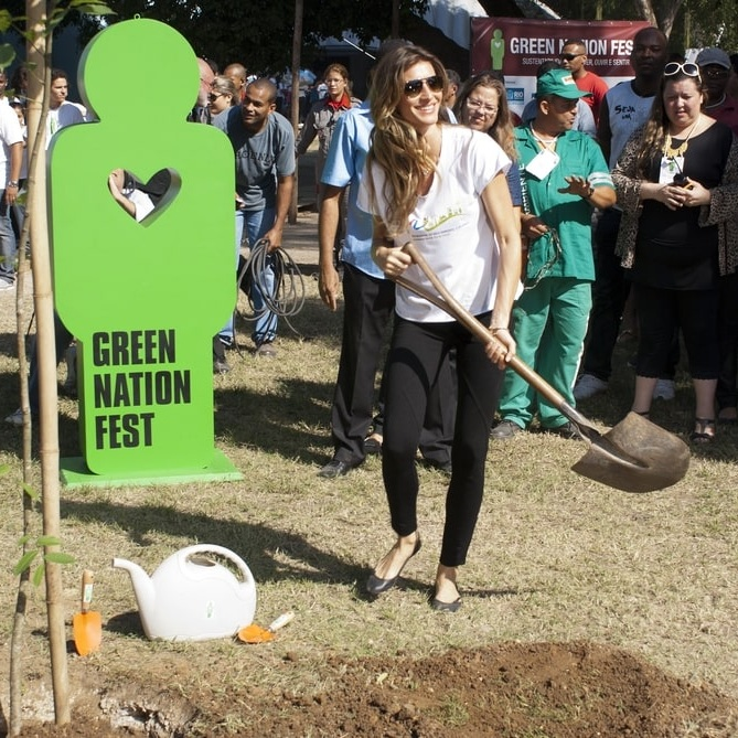 Gisele Bundchen planting a tree at the Event Green Nation Fest