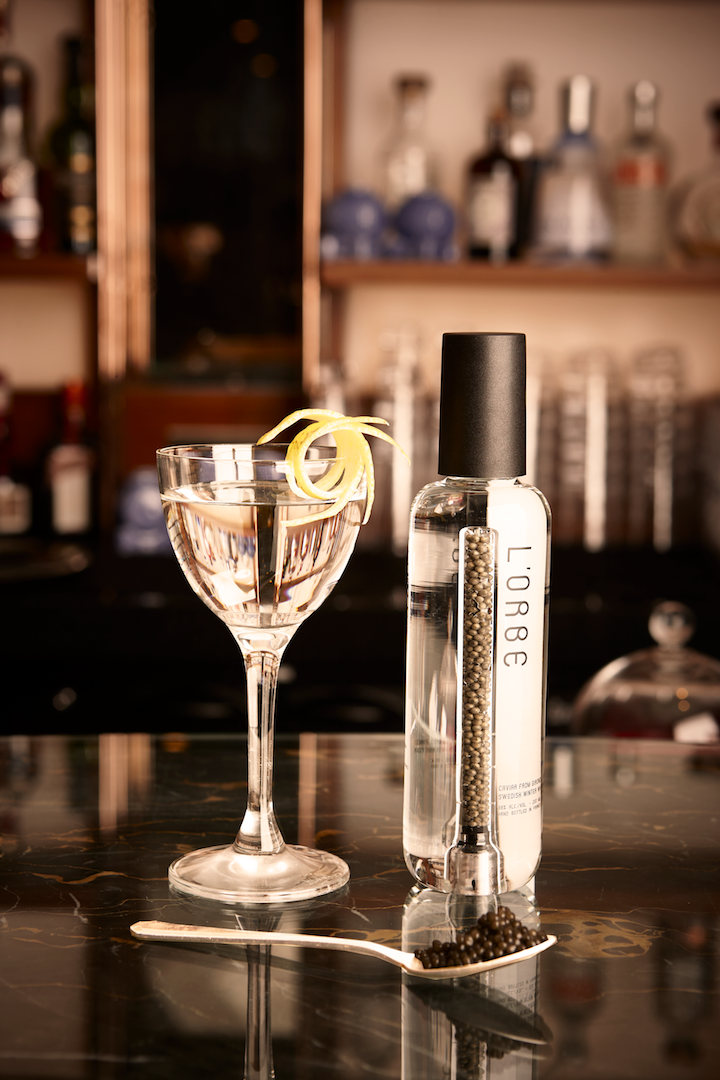 Bottle and glass with L'Orbe Caviar Vodka