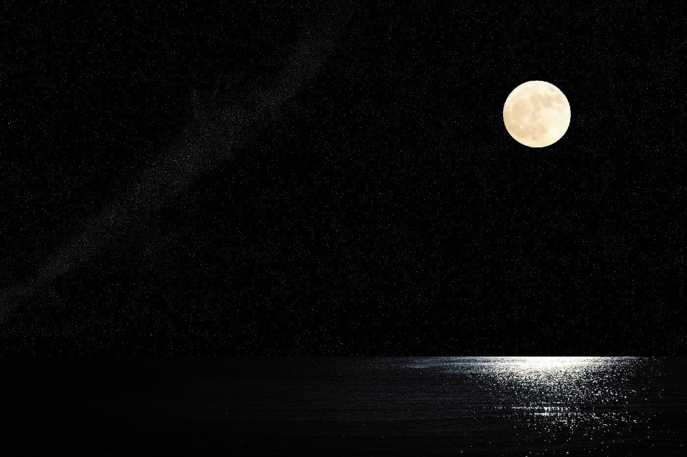 Lunar cycle moon over sea