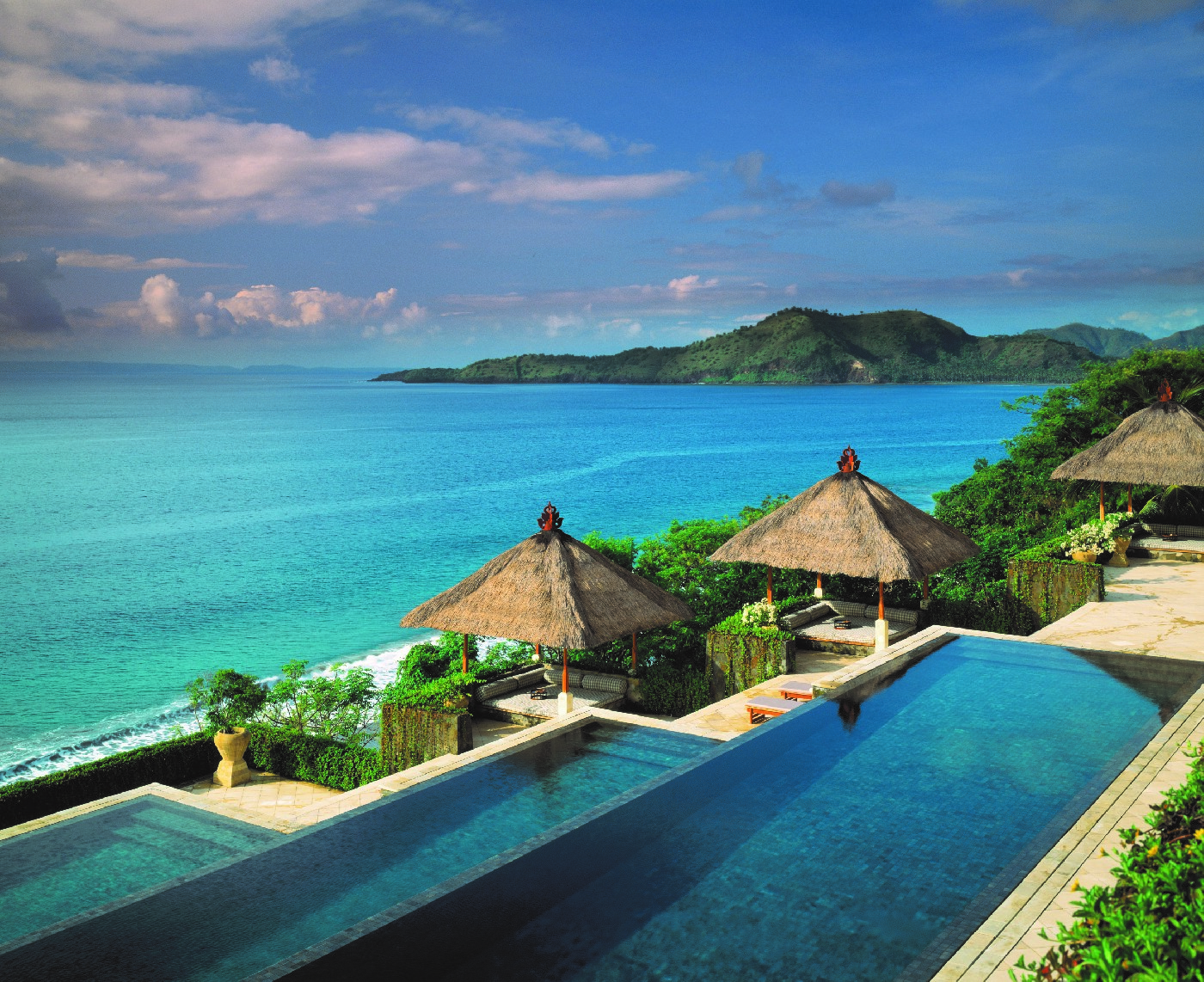 Infinity swimming pools with ocean and mountain views