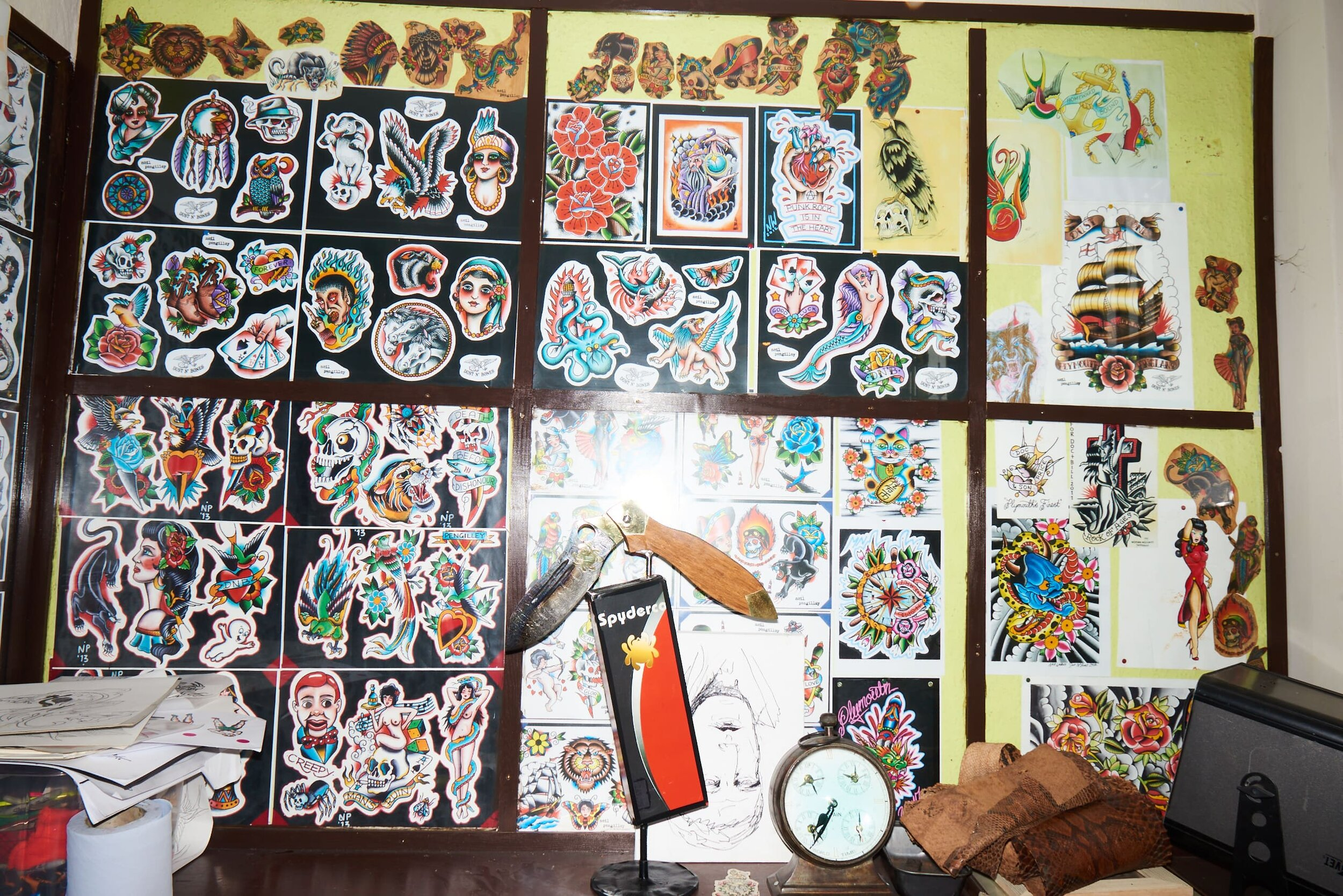 A wall of tattoo illustrations in Doc Price's shop