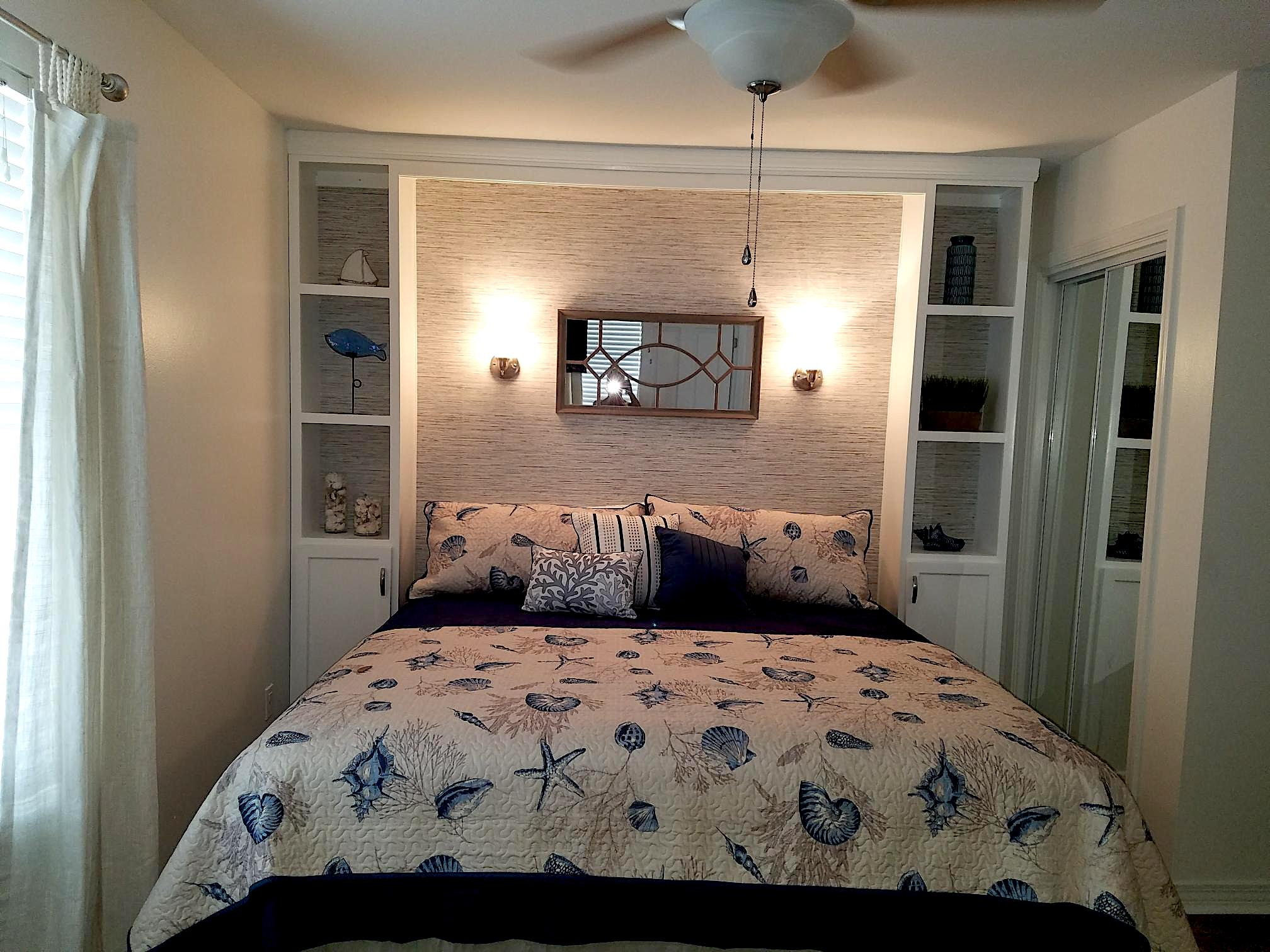 Master Bedroom with Sconces and Mirror .jpeg