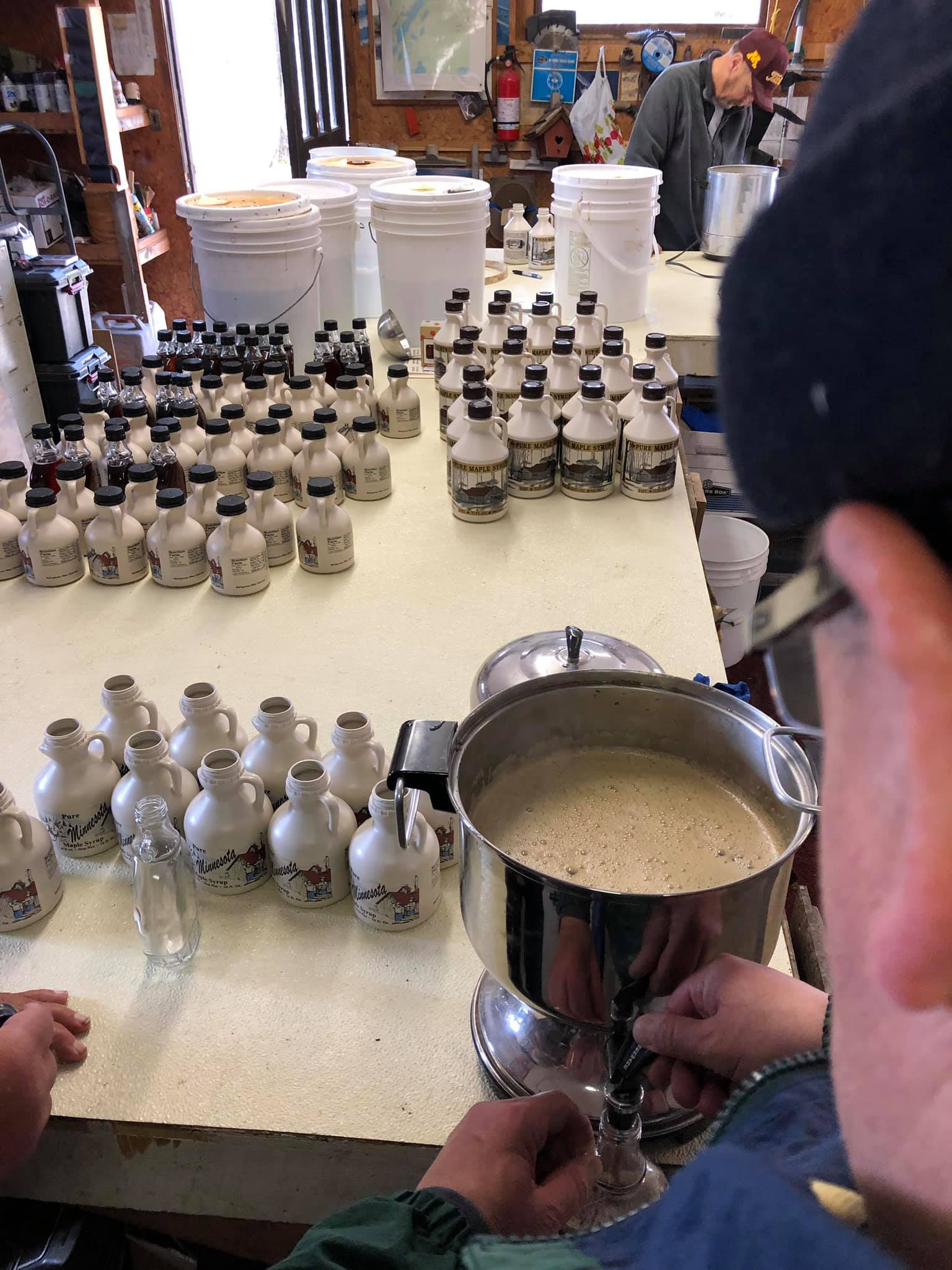"After the syrup is filtered through dozens of layers of cheese cloth we pour it into a repurposed coffee pot, aka ""maple pot"". It will be put into bottles immediately while steaming hot to get the best seal."