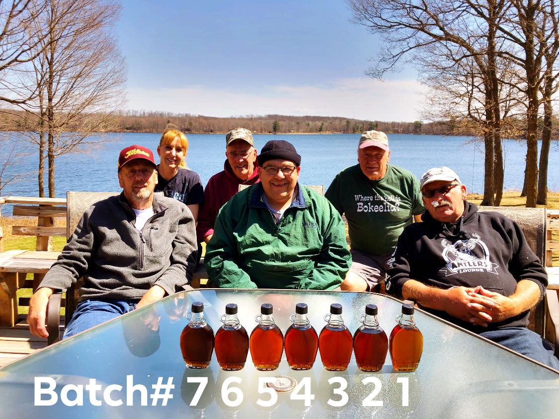 Maple Syrup 2019, 1350? gallons boiled in 7 batches. Samples from each batch are shown. The last of the season are on the left to the first of the season are on the right. The beginning is always lighter, with possible changes according to weather and temperature, affecting how fast the trees run, though always consistently graduating to a dark color by the end of the season. There was debate about the light color of batch number 5 being associated with a snow storm, and 2 seemed pretty dark for the beginning of the season, but wow does it taste GOOD. Left to right: Gary Clark, Jackie (Hakes) Brix, Bill Hakes, Dave Hakes, Jim Hakes, Les Fischer.