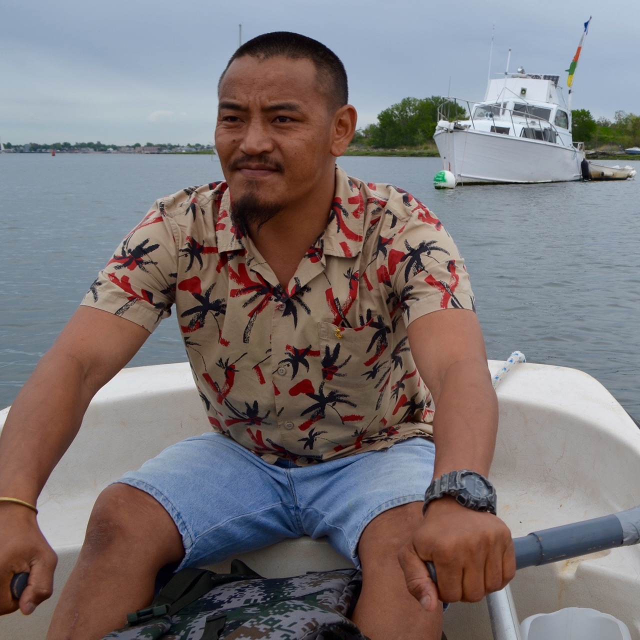 Nepal native Gigmy Bista has to row to shore from his City Island houseboat for fresh water. The lifestyle reminds him of back home.