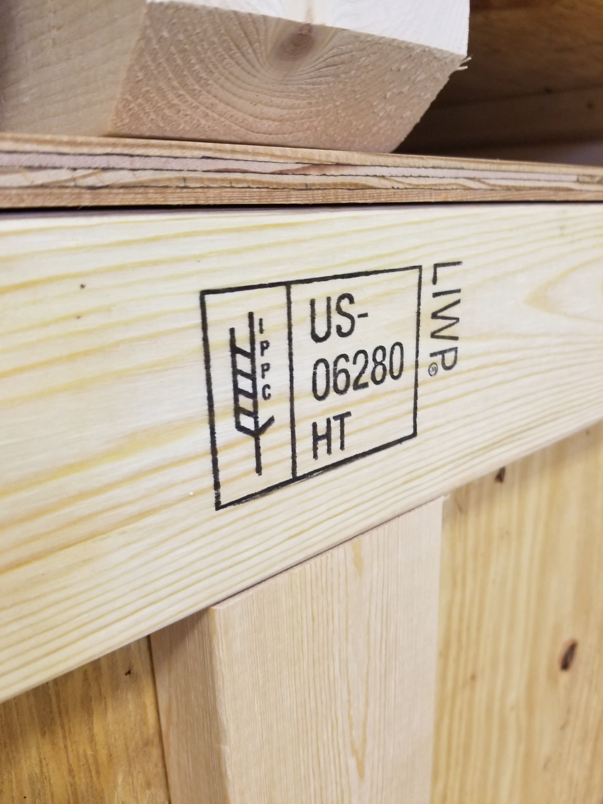 Specialty Crate Factory ippc/ISPM-15 Certification Stamp - A properly stamped, certified international shipping crate ready for export overseas.