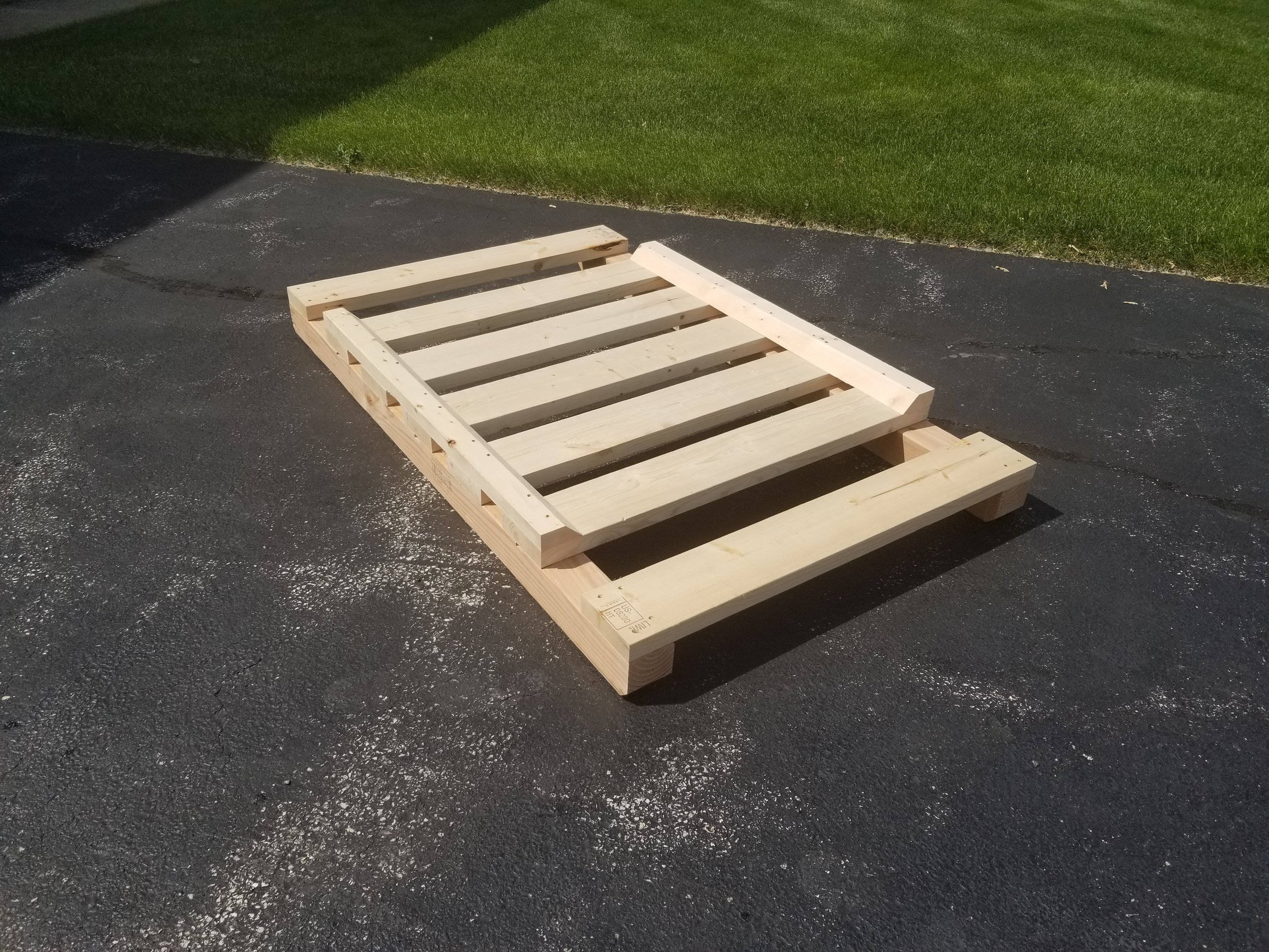cylinder pallets - Heavy duty pallet designed to hold multiple pieces of cylindrical shaped cargo. ie: Tubing, Piping, Gas cylinders, Steel bars, etc.There are special notches on the sides for securely banding a stack of cylinders to the skids and then angled lumber keepers to, yep, KEEP them there!
