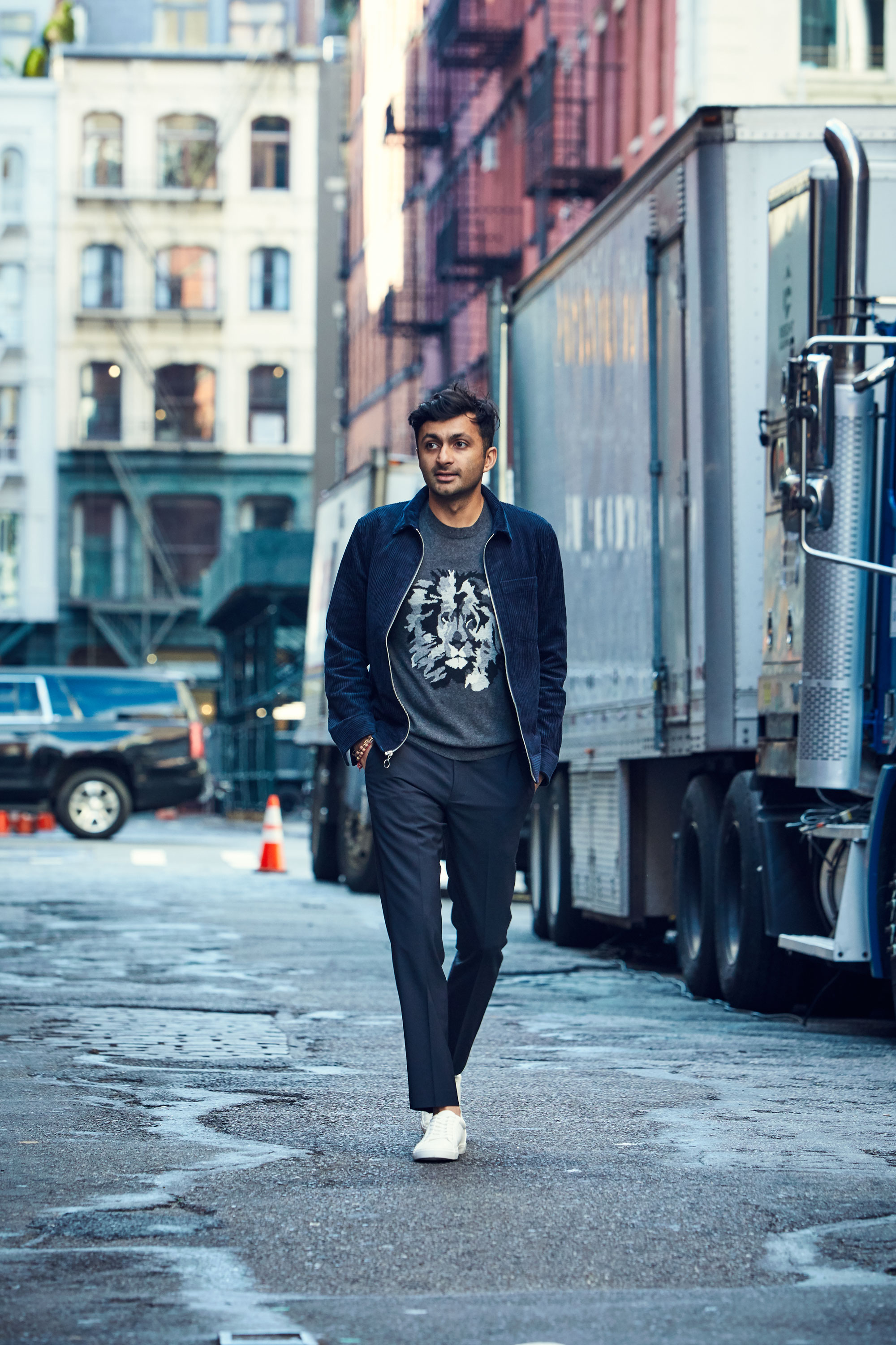 Nimesh in the streets wears the    Lightweight Wool Crew Neck (Charcoal Lion)   , the    Corduroy Shirt Jacket (Navy)   , and the    Stretch Wool Dress Pants (Navy)
