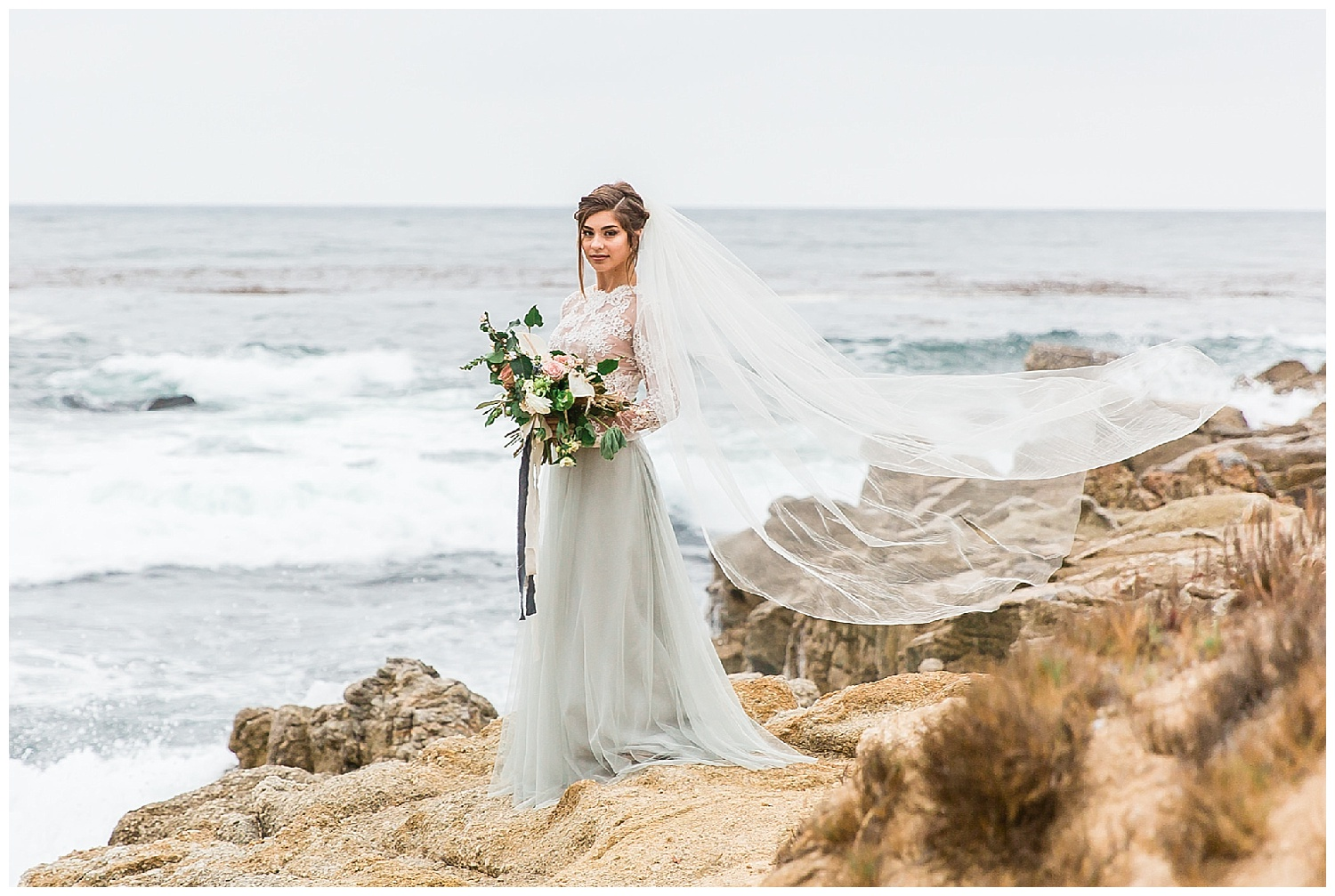 The bride in a sheer lace top with a French Blue English netting skirt. Custom made cathedral veil. All available through Epiphany Bridal Boutique in Carmel-by-the-Sea, California.