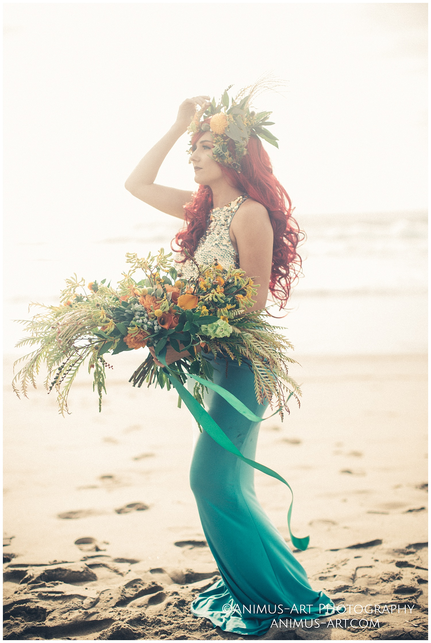 Mera Portraits at the beach bohemian floral crown and bouquet.jpg