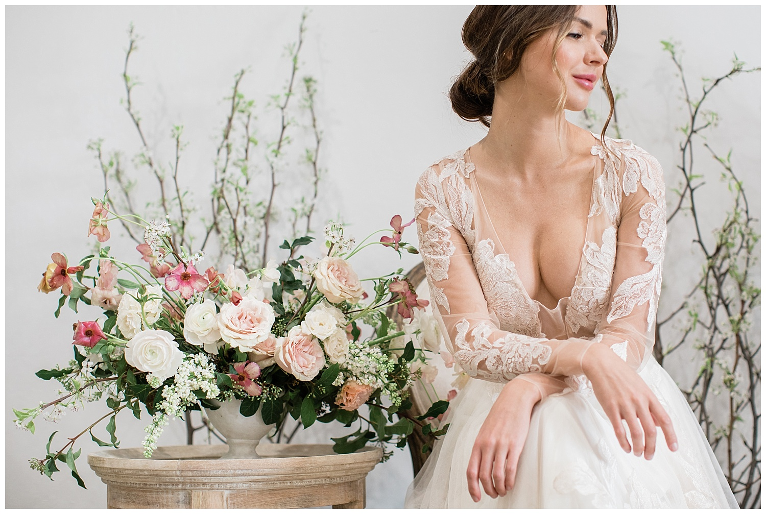This gorgeous gown is completely made from lace appliqués over tulle. Strategically placed for coverage and style. Photography  Carlie Statsky  Florals  Gavita Flora