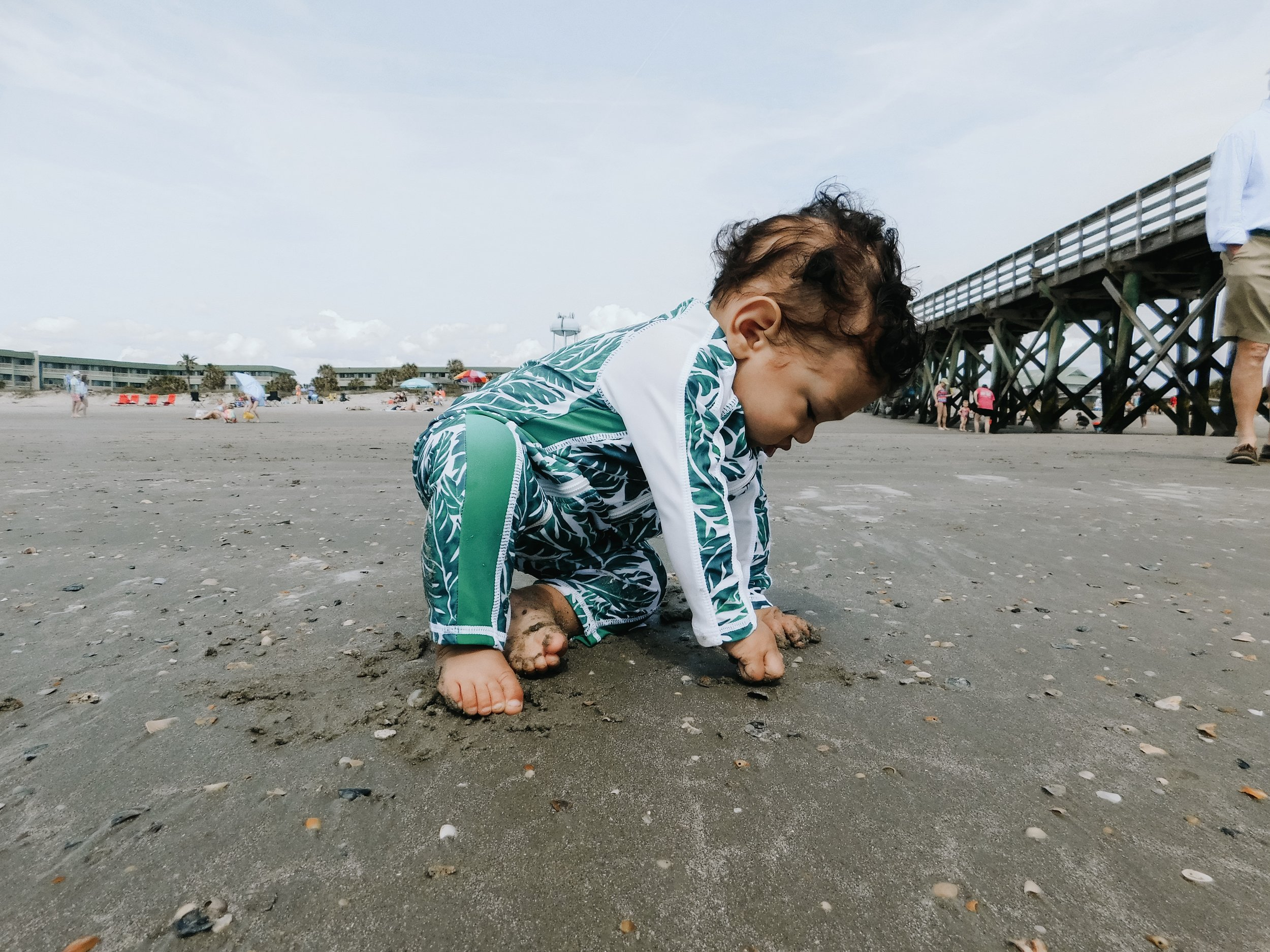 Was really hoping his first time crawling would happen at the beach..