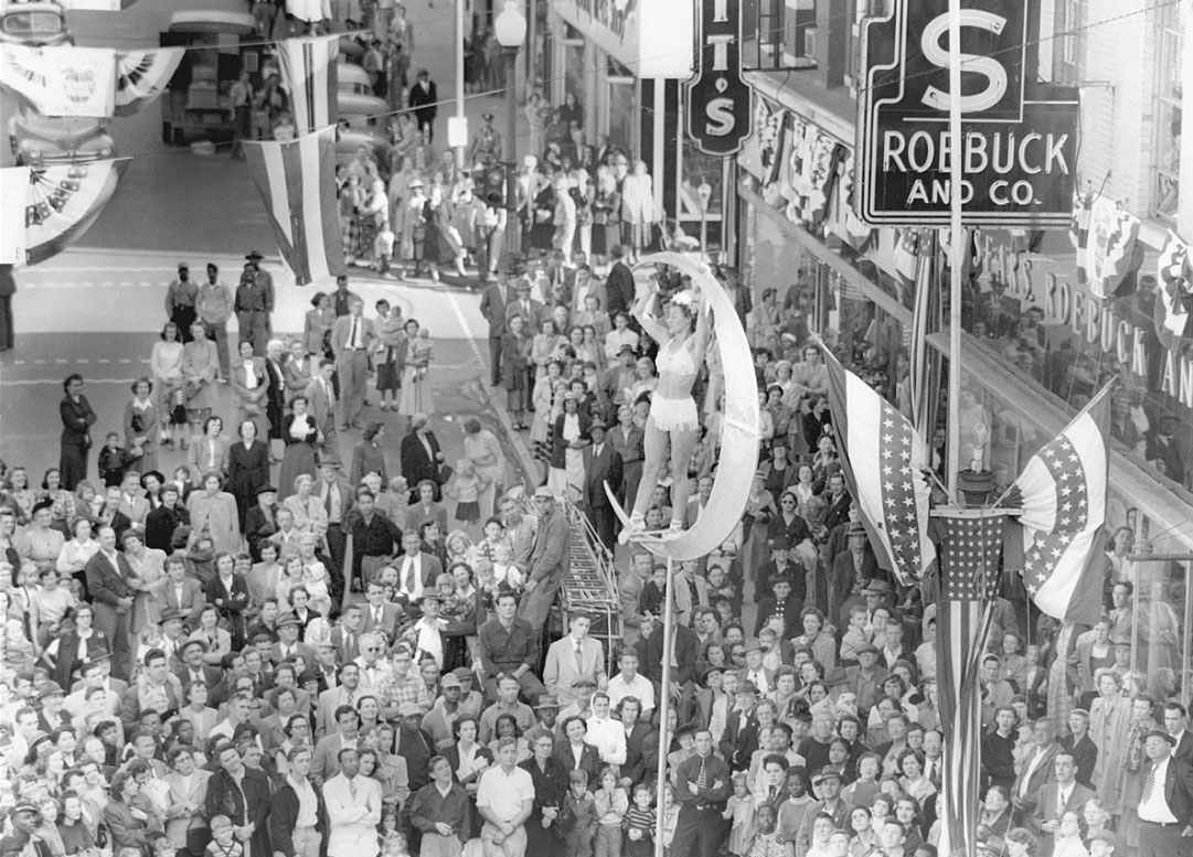 Hundreds of people gathered on Main Street one afternoon during the Apple Harvest Festival in 1951 to watch the acrobats.  (Courtesy Ed Roseberry.)
