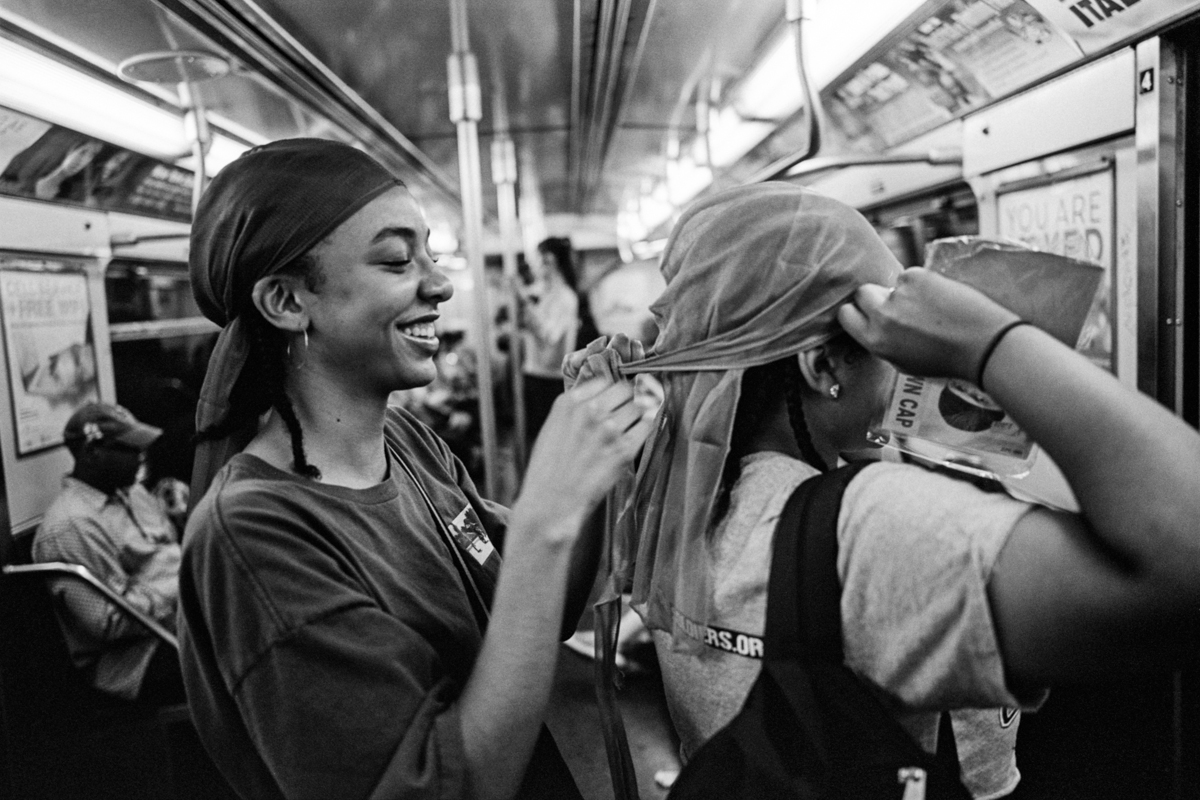 """An Ode to Acts of Kindness on the New York City Subway - """"The New York City subway is this great equalizer,"""" said the photographer Andre Wagner, who spent four years taking photographs on its platforms and in its cars. """"For this brief moment in time, we're all in it together.September 16, 2017"""