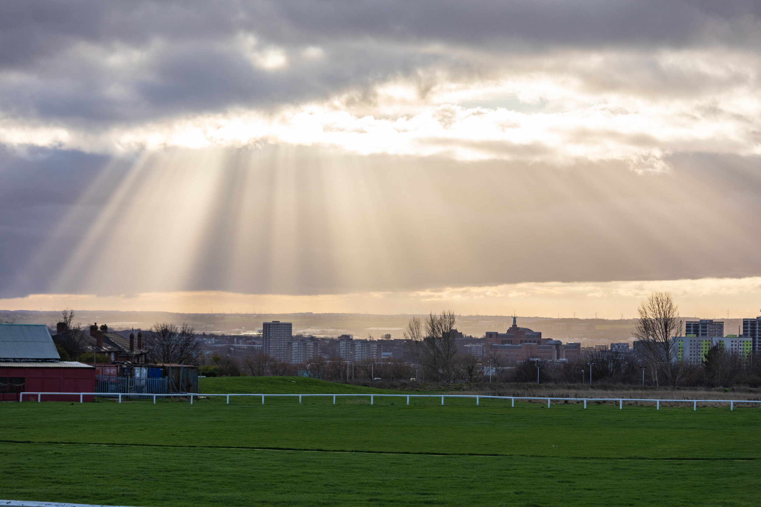 Sunlight breaking through the clouds on Scott Hall Field, Leeds