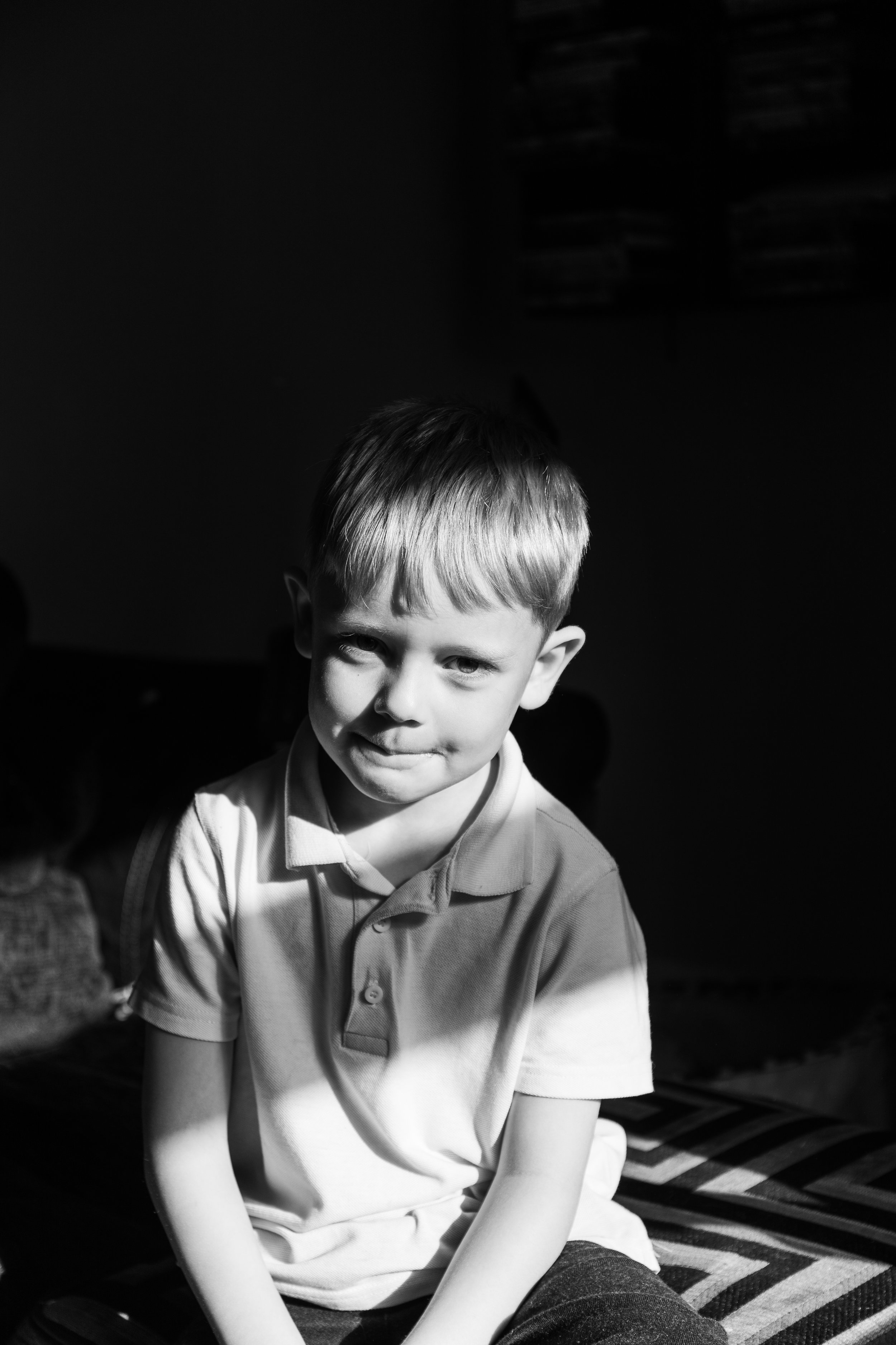 little boy in black and white