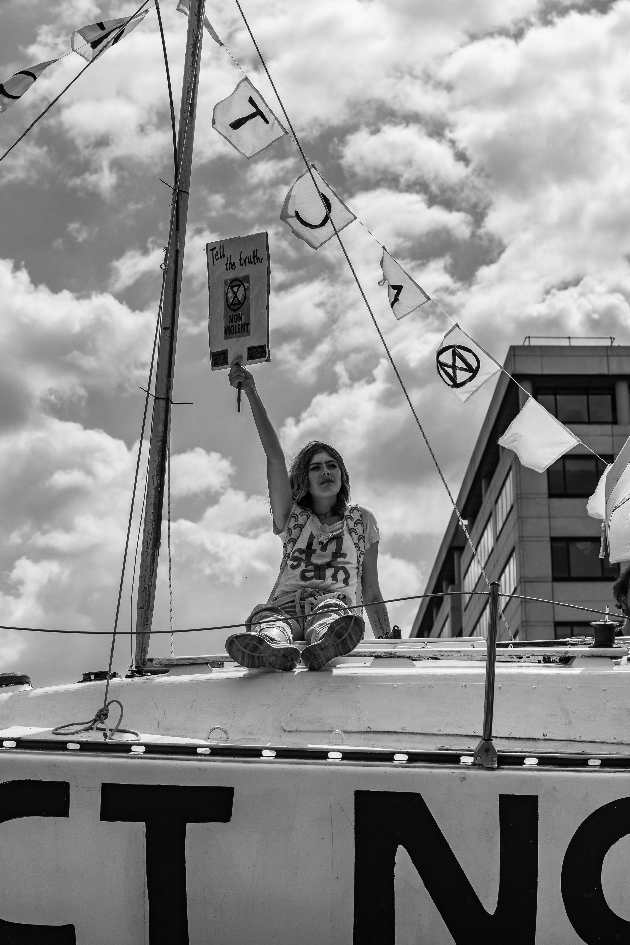 A protester sat on the boat - Image is copyrighted.