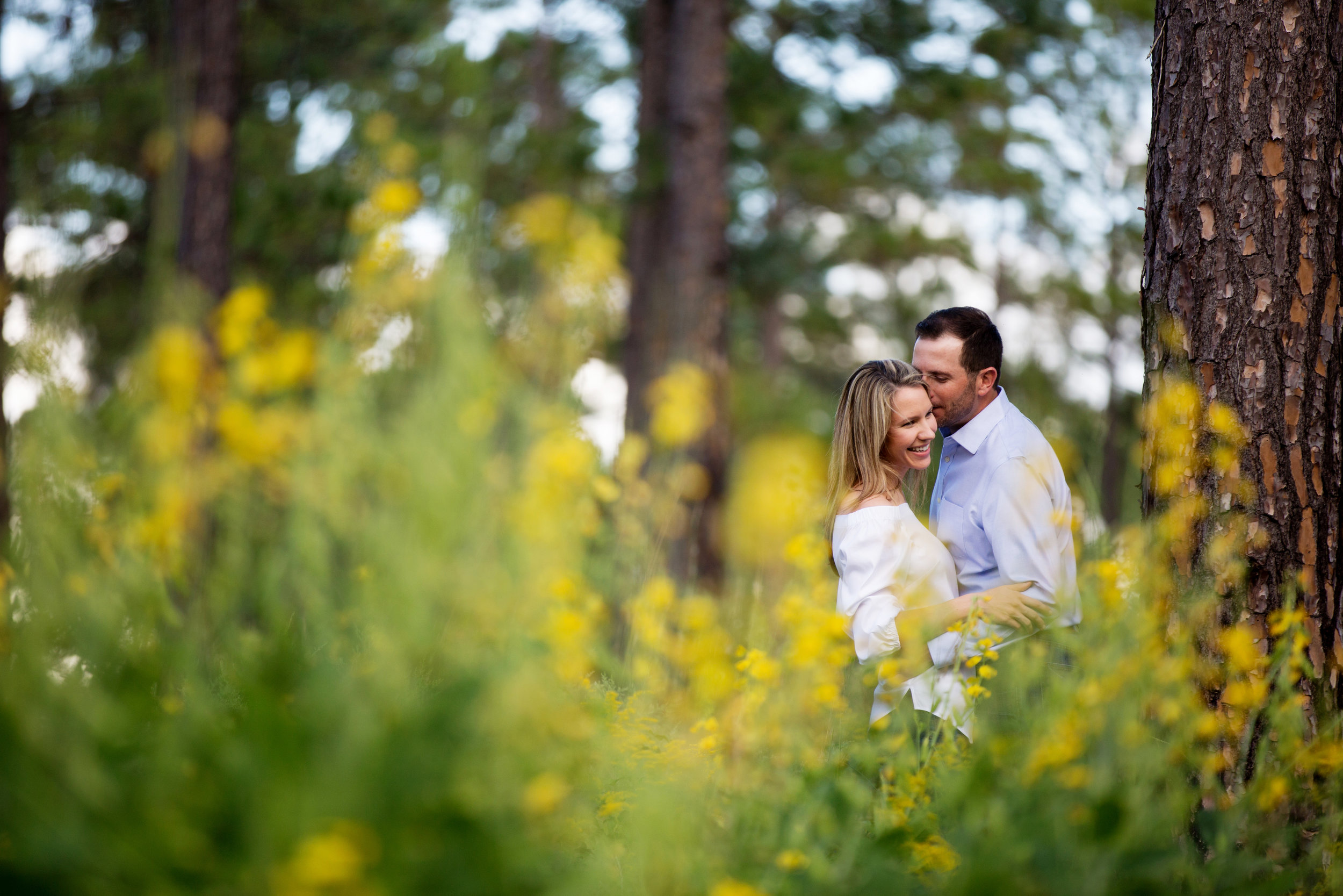 Outdoor Engagement Photography in a field with yellow flowers