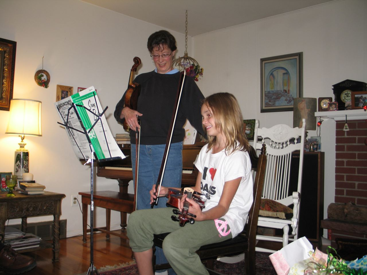 Teaching young violinist Cami