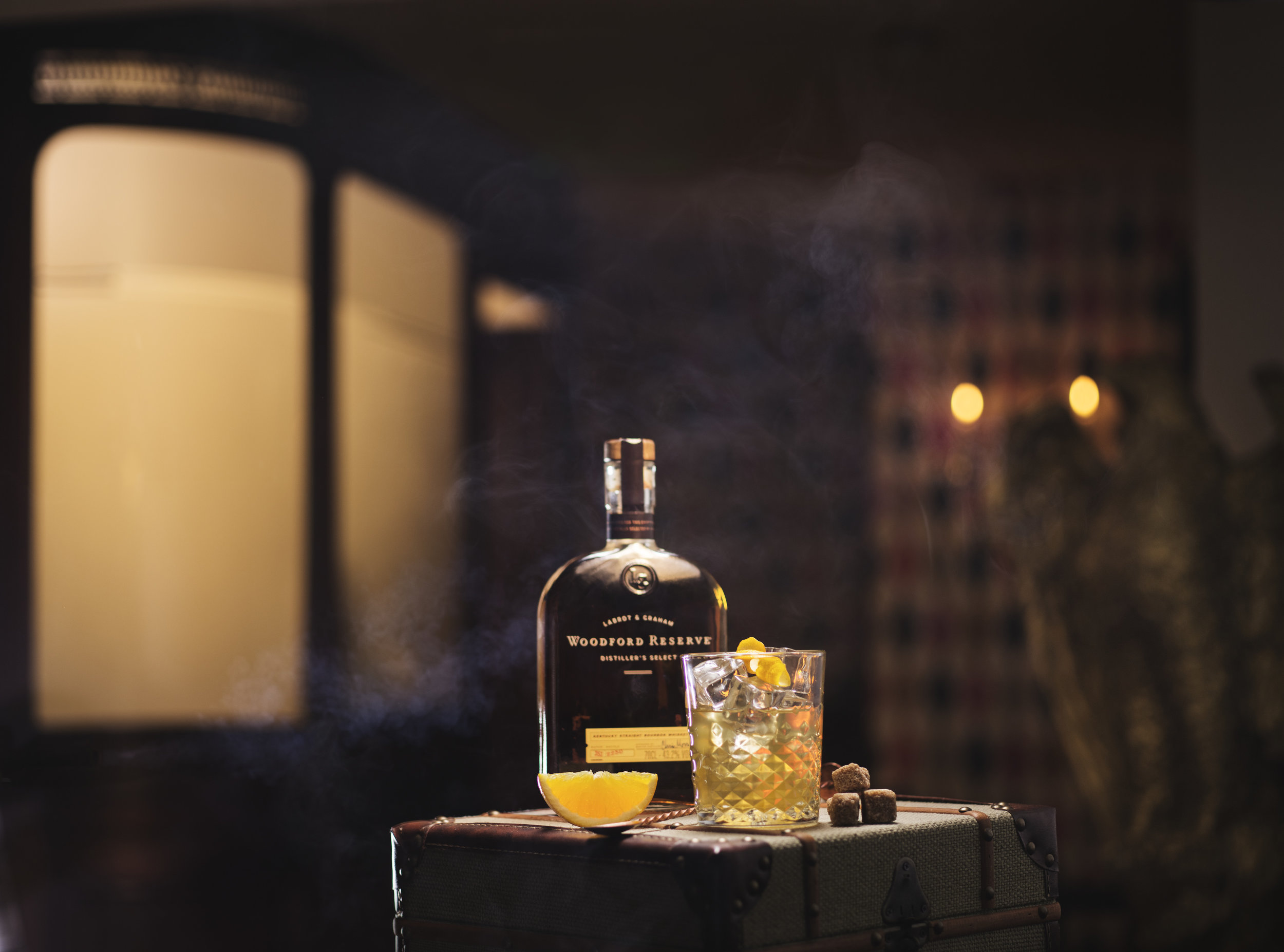 woodford reserve old fashioned cocktail with bourbon, still life cocktail drink shoot. advertising, packshot, candlelit and cosy. lifestyle campaign images with atmosphere. Whisky, vodka, coffee, interior shots.