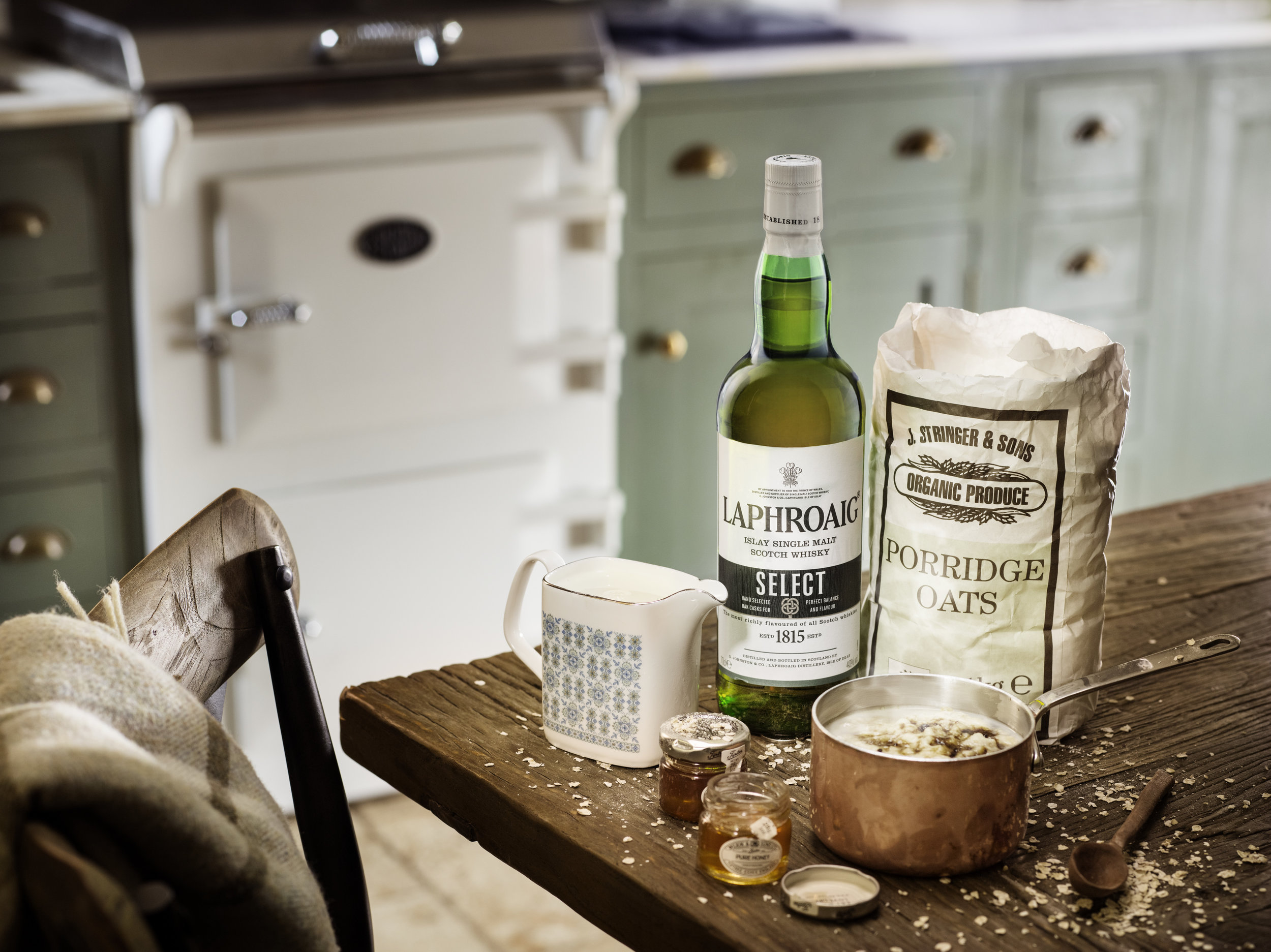 breakfast laphroaig with porridge, still life cocktail drink shoot. advertising, packshot, candlelit and cosy. lifestyle campaign images with atmosphere. Whisky, vodka, coffee, interior shots. whiskey