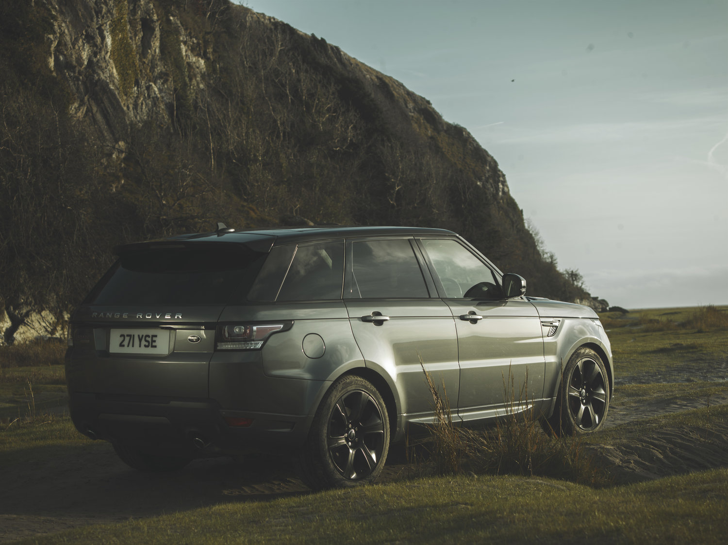 Range Rover Sport tyre tracks on the beach sand. Commercial advertising automotive photography. off road in the Lake District, Cumbria for Land Rover. Packshot. Highlighting the Great British Outdoors, craftmanship and heritage brands