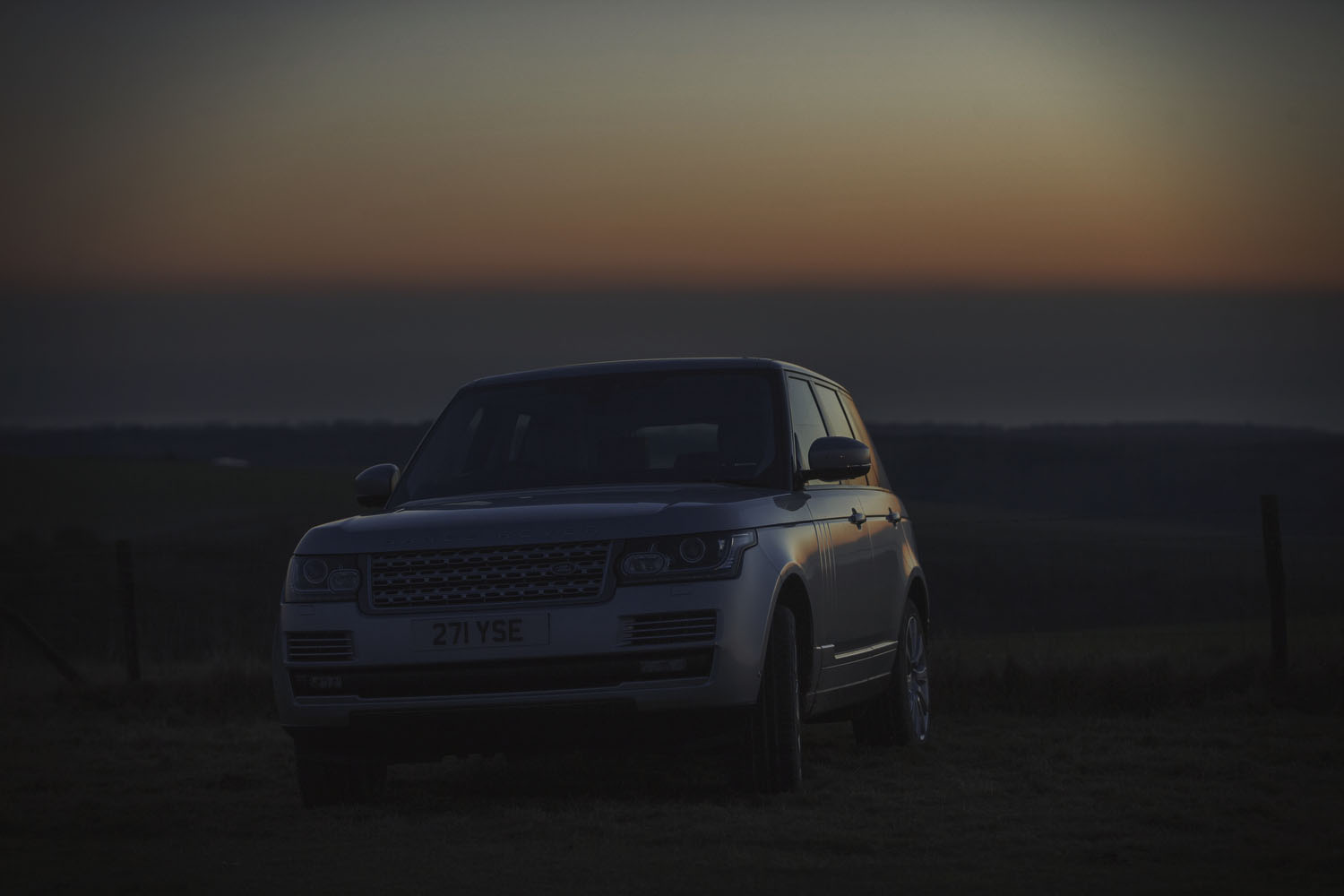Range Rover silhouetted at sunset during a Commercial advertising automotive photography shoot.  off road in the Sussex for Land Rover. Packshot. Highlighting the Great British Outdoors, craftmanship, rural life and heritage brands. food photography still life.