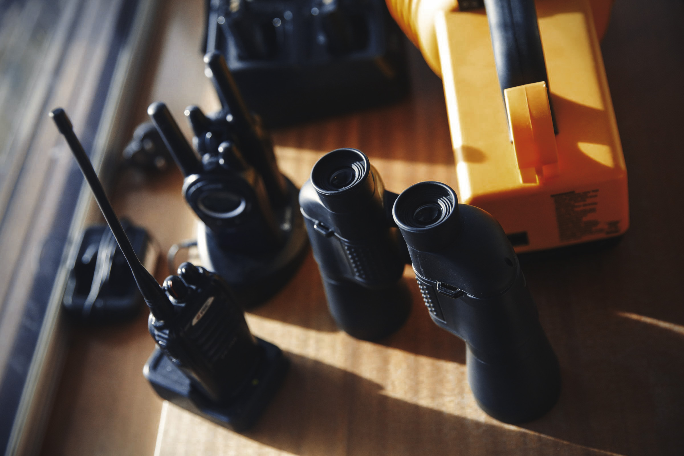 still life of walkie talkie radios, binoculars and other maritime equiopemnt