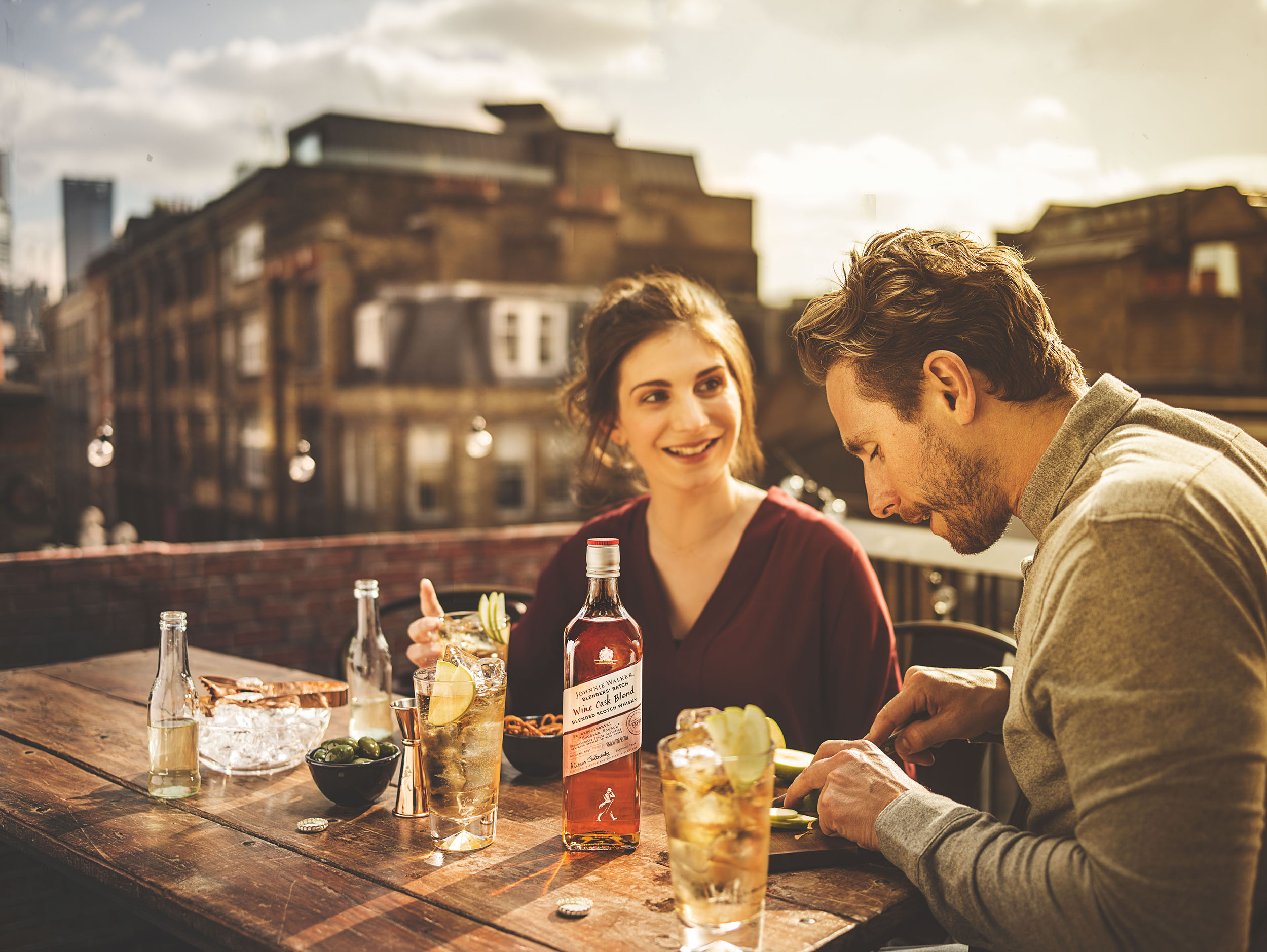 relaxed natural reportage of drinks lifestyle on a london rooftop by advertising commercial and lifestyle photographer matthew lloyd based in leeds york and harrogate sheffield