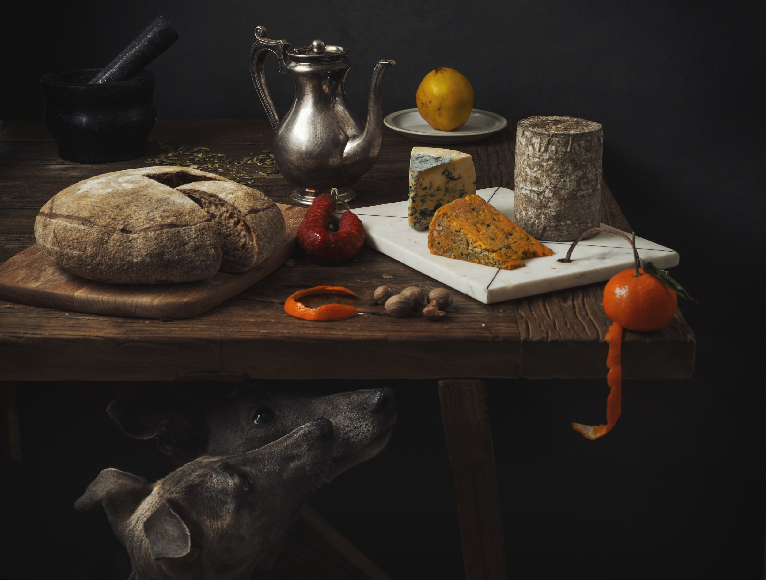 A table of cheese, bread and meat inspired by the Dutch Masters - still life