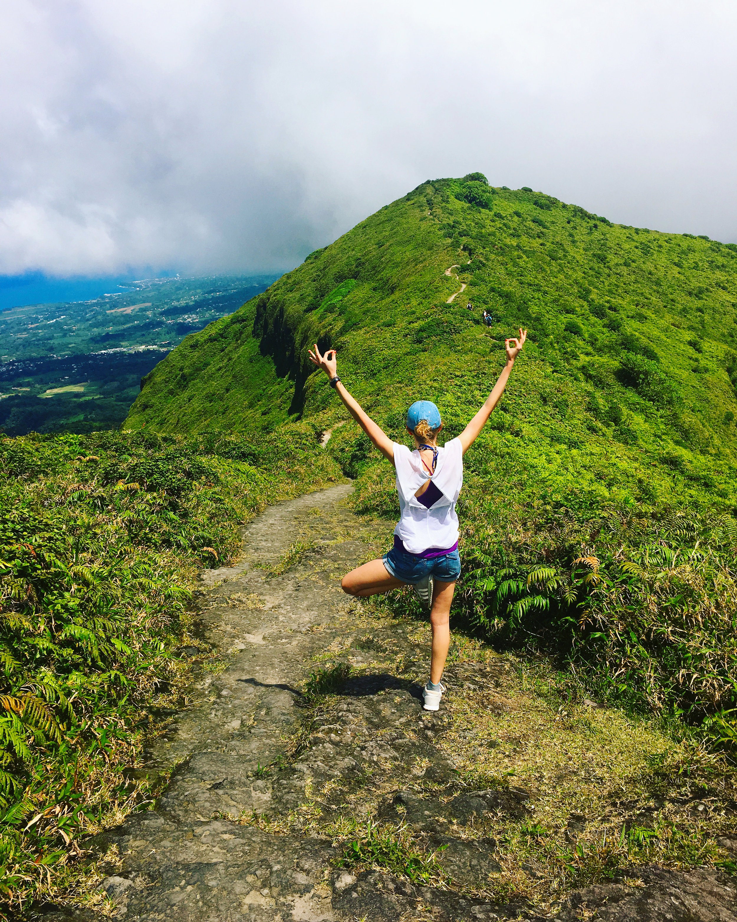 Founder + CEO Kayla Clements hiking Mount Pelée in Martinique