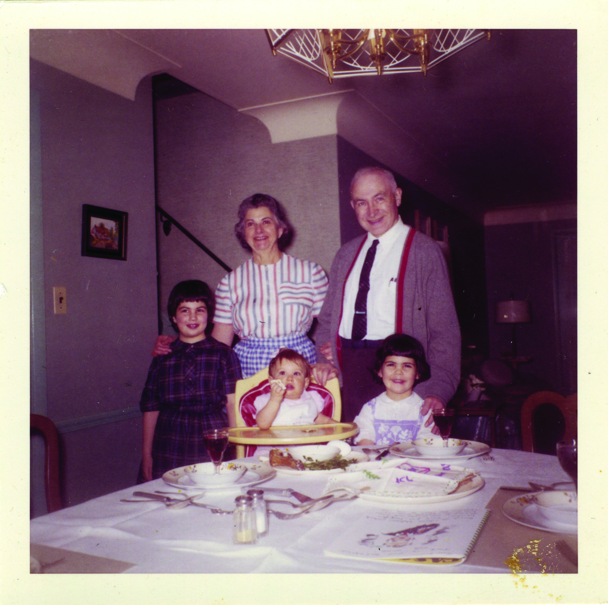 See the little girl with dark hair? That's me, Carla. Happy to have my Grandpa Abe over my shoulder. -