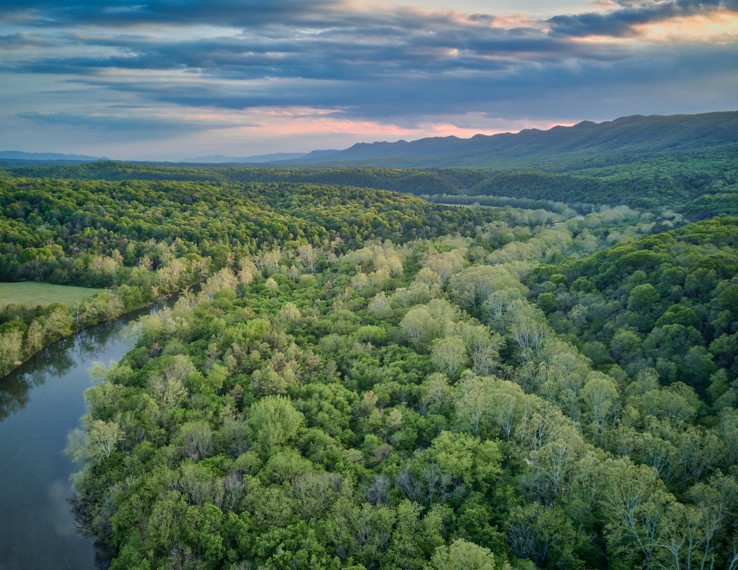 I love this shot I snagged of the Shenandoah Valley.My favorite part of an aerial image like this is the nuance in texture, from the leafy trees reflected in the still river to the touch of golden sunset.