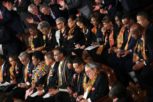 bellanaija.com  Black members of the US Congress on Tuesday made scarves and ties out of traditional  Kente  fabric, which originated from Ghana, as they attended President Donald Trump's first State of the Union address.