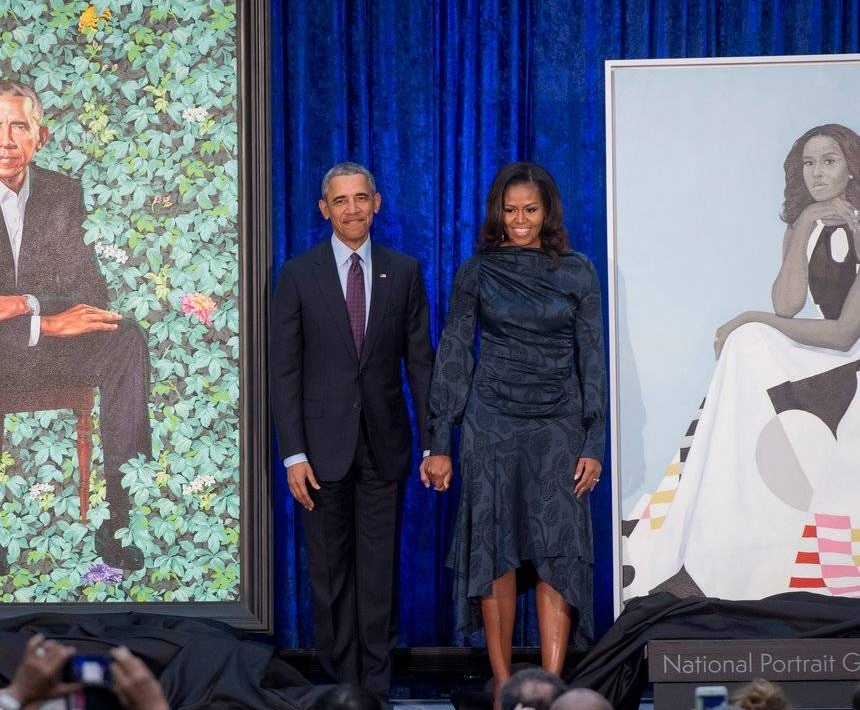 essence.com  Barack and Michelle Obama returned to the spotlight Monday morning to unveil their official portraits.