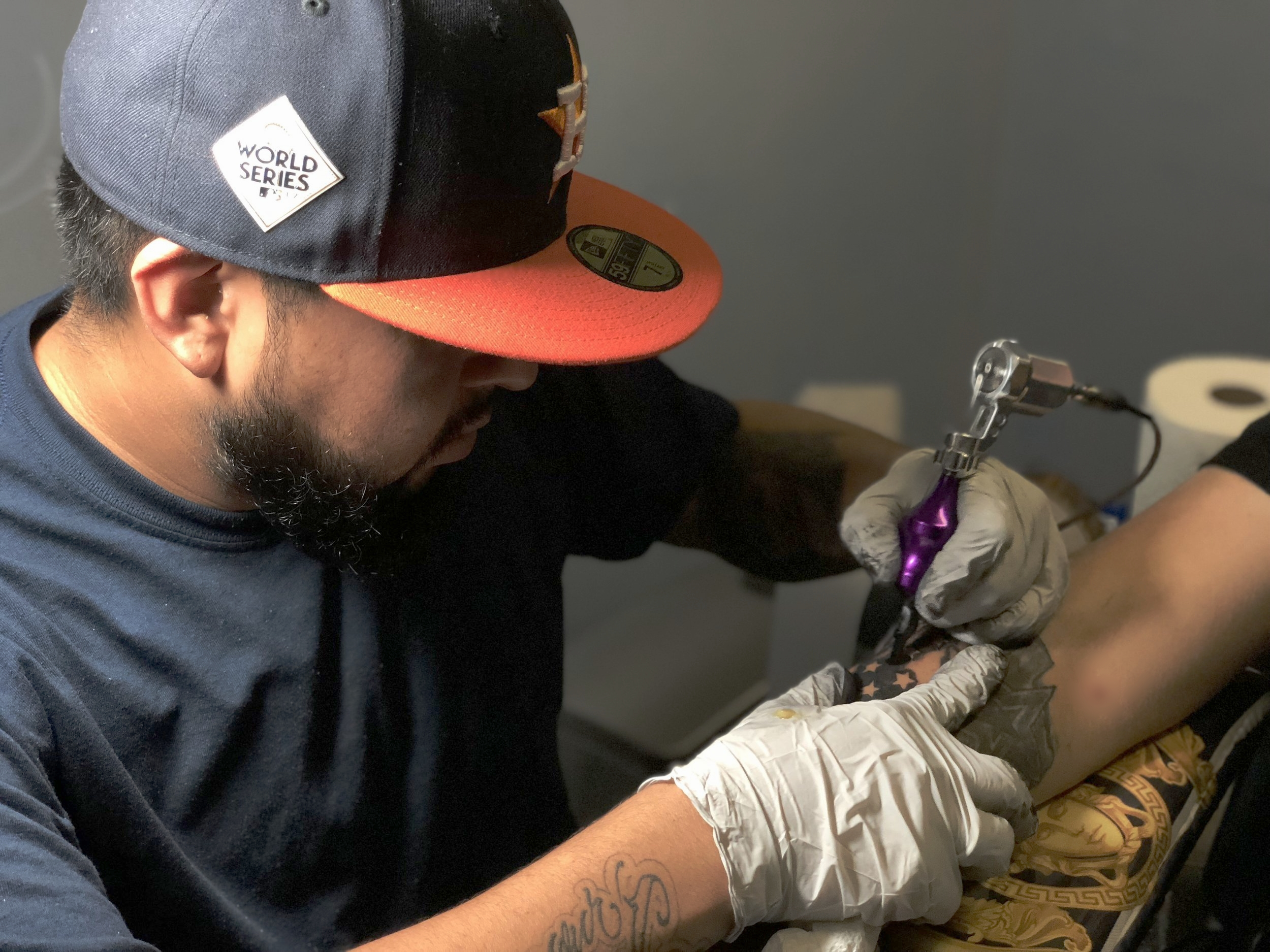 Rey Garcia - Rey is an artist out of Houston, Texas. He has been tattooing professionally for about 3 years. Rey specializes in script and black and gray realism, considers himself a pretty versatile artist and can do it all. Click on his photo to check out his work!