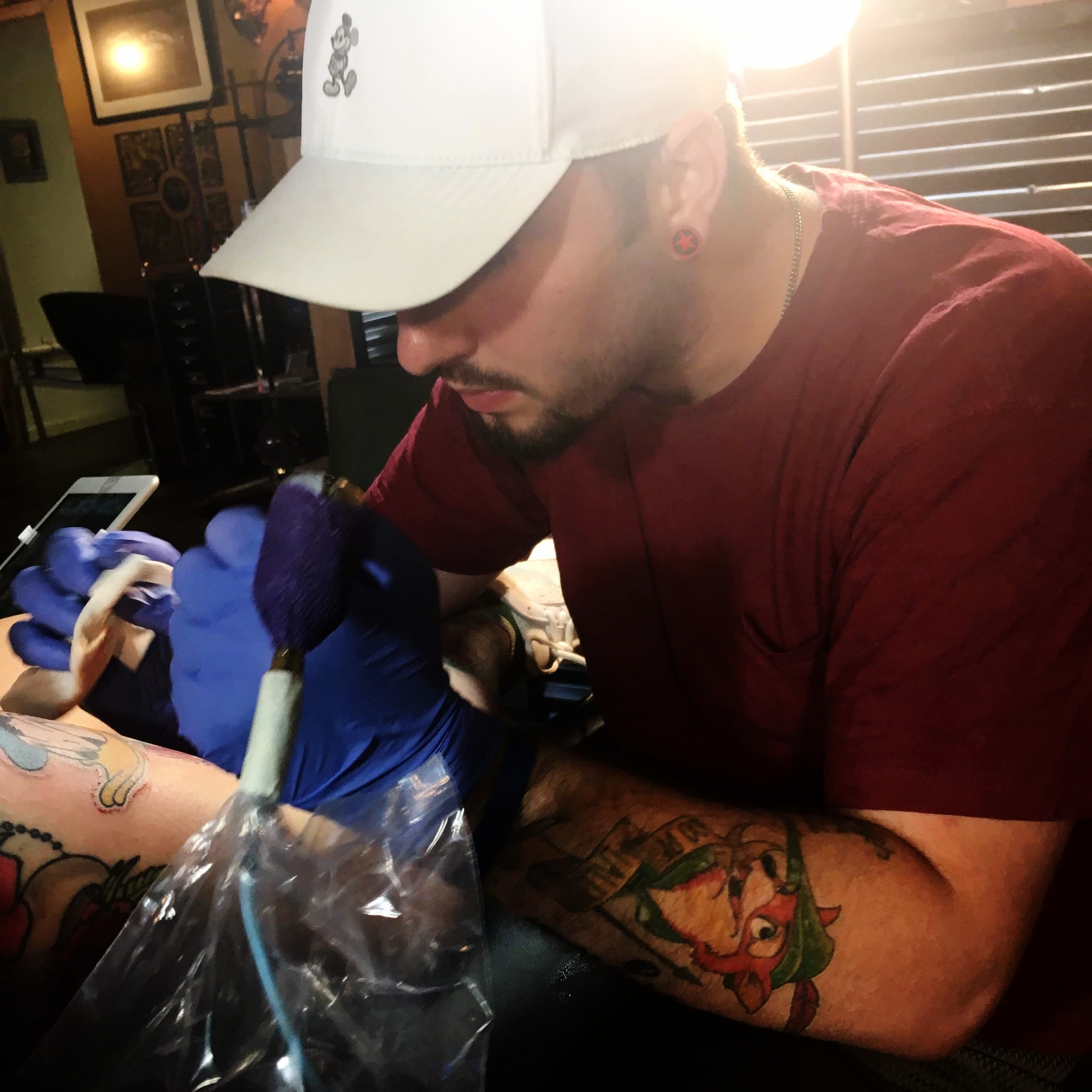 Jesse Bandit - Jesse has been tattooing since 2017. He enjoys tattooing anything horror themed, cartoon, neotraditional as well as black and grey. Jesse is well rounded in most styles but enjoys color the most for the blending. He is more known for his brighter color works. Click his photo to check out his work!