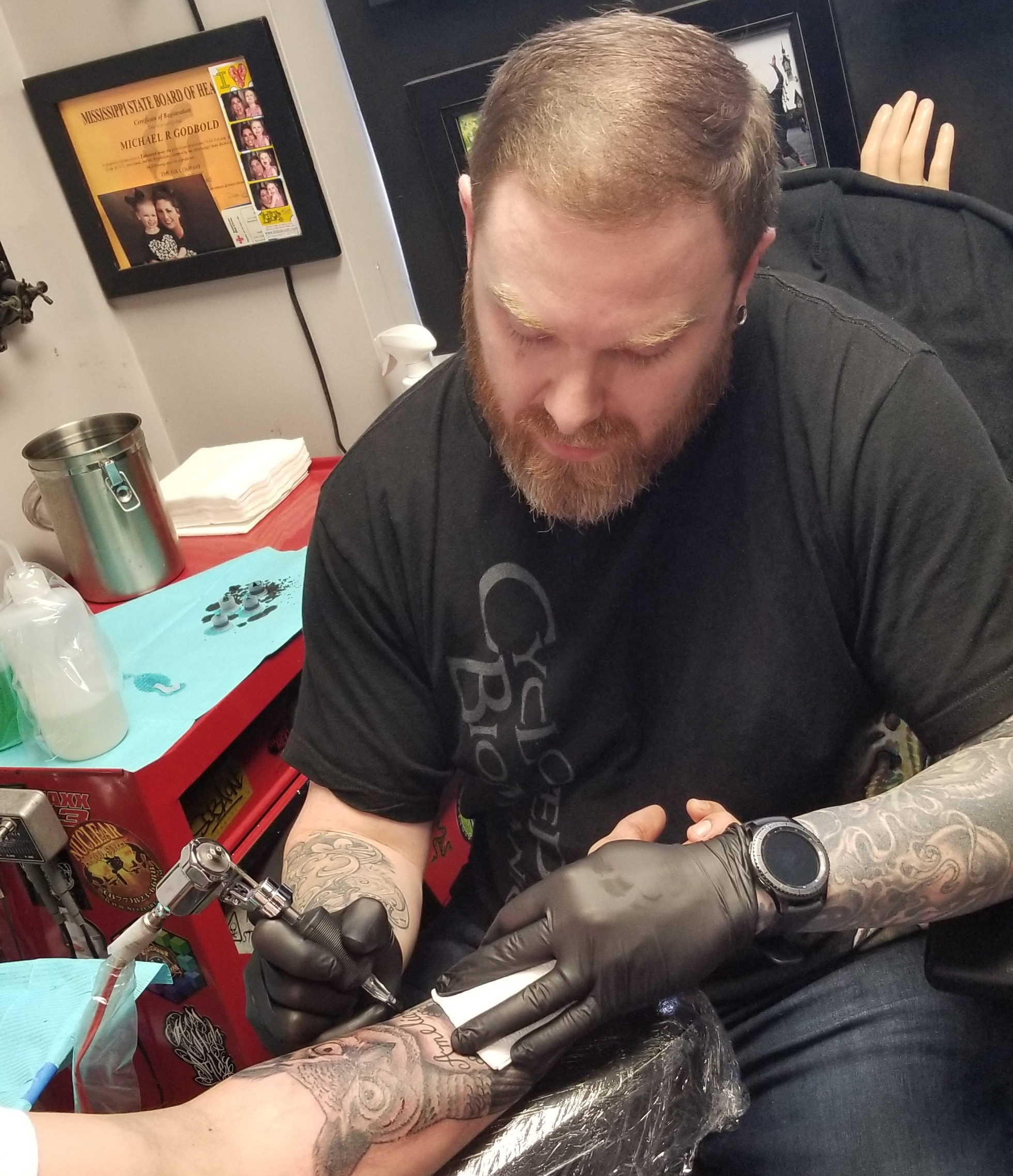Mikey Godbold - Mikey has been tattooing since 2001. He co-owns The Ink Company Tattoo Studio in Harriesburg, MS and has been there the last 11 years. Mikey is a fairly diverse artist but specializes in bio-organic and custom black and grey work. Click his photo to check out his work!