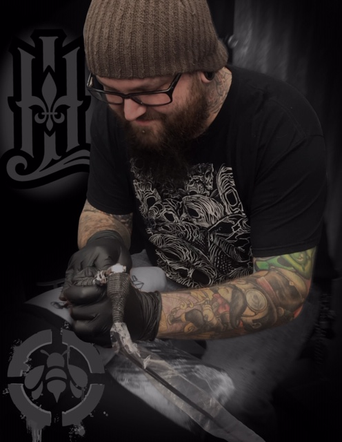 Timmy Bee - Timmy Bee is an award winning artist based out of Michigan, tattooing since 2001. Though versatile as an artist, he specializes in bold/new school colors and neo traditional. Click his photo to check out his work!