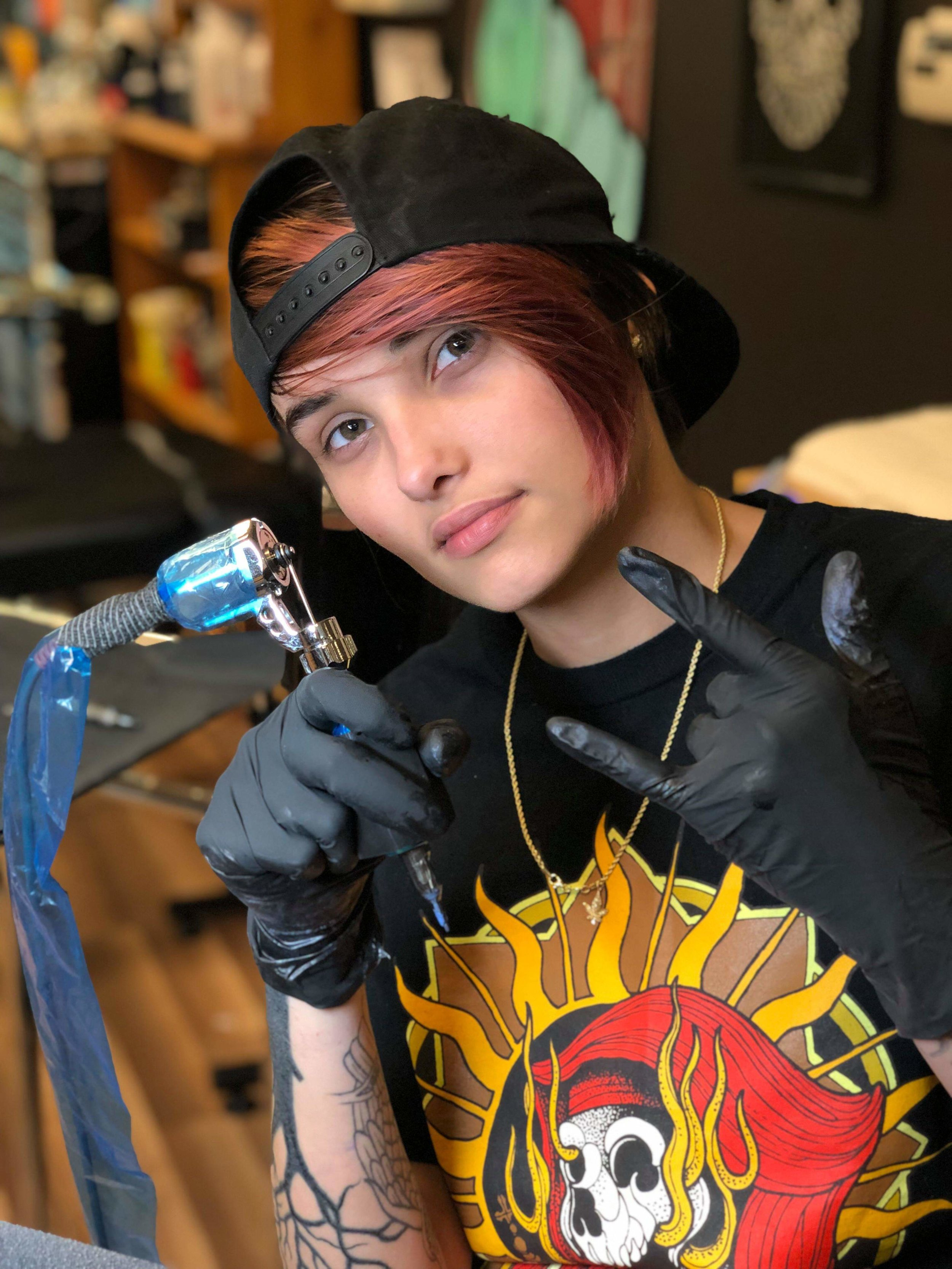 Bri Johnson - Bri tattoos in Arizona. She enjoys doing all types of tattoo styles. Bri likes to create custom designs for her clients that match their personalities. Her passion is tattooing. Click her photo to check out her work!