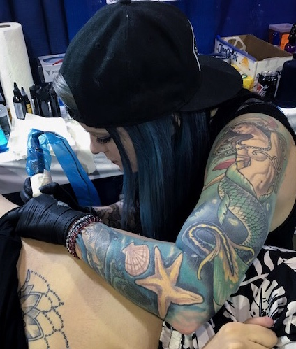 Kelly Holman - Kelly was born and raised in New Jersey and has been tattooing for 4 years. She likes to do pretty much any style but enjoys doing animal and nautical themed tattoos. Click her photo to check out her work!
