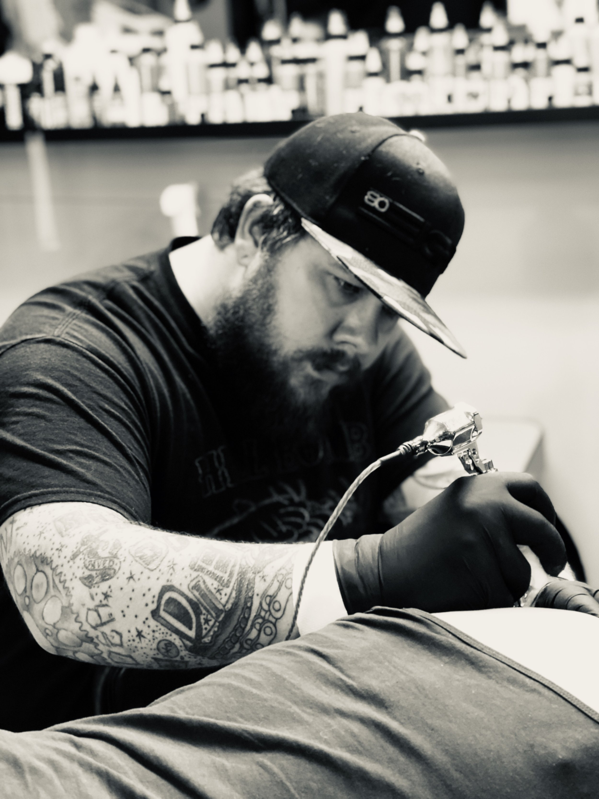 Dooner Sadauskas - Dooner started tattooing in Daytona Beach, FL, but later moved back to his hometown just outside of Pittsburgh, PA where he has been tattooing ever since. He has been tattooing for 13 years and has owned a successful tattoo shop of his own for the past 10 years, called Up In Arms Tattoo. He is definitely well-known for his work with realistic black and gray portraits, but can do any style you throw at him. Recently, Dooner has taken a huge interest for single needle, fine line tattoos. Click his picture to check out his work.