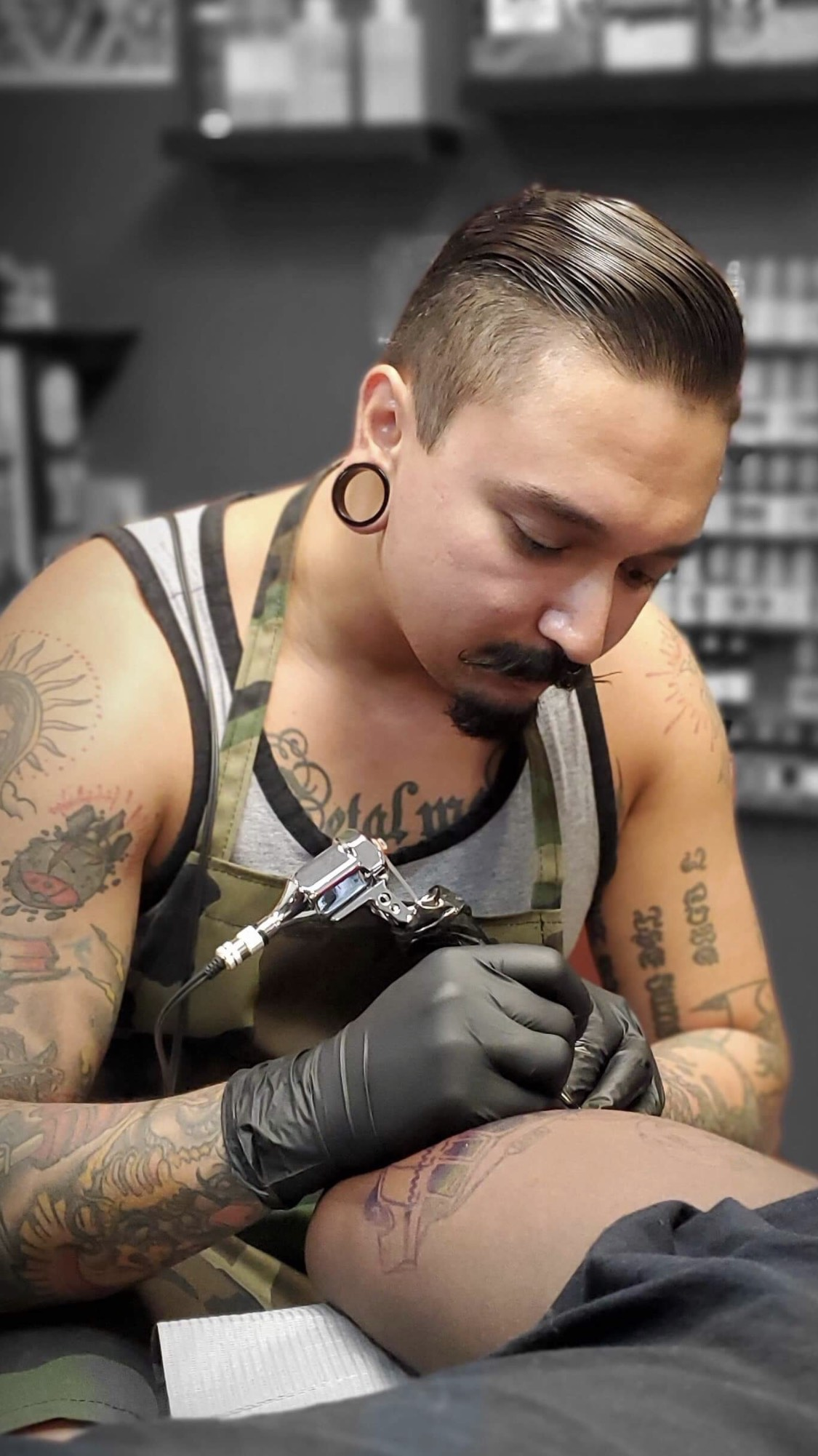 Joel Macias - Joel has been tattooing for 6 years. He is a well known artist for black and grey, geometric as well as traditional. Although these are some of his specialties he is multitalented in all styles. Located in Hope Mills, NC. Click his picture to check out his work.