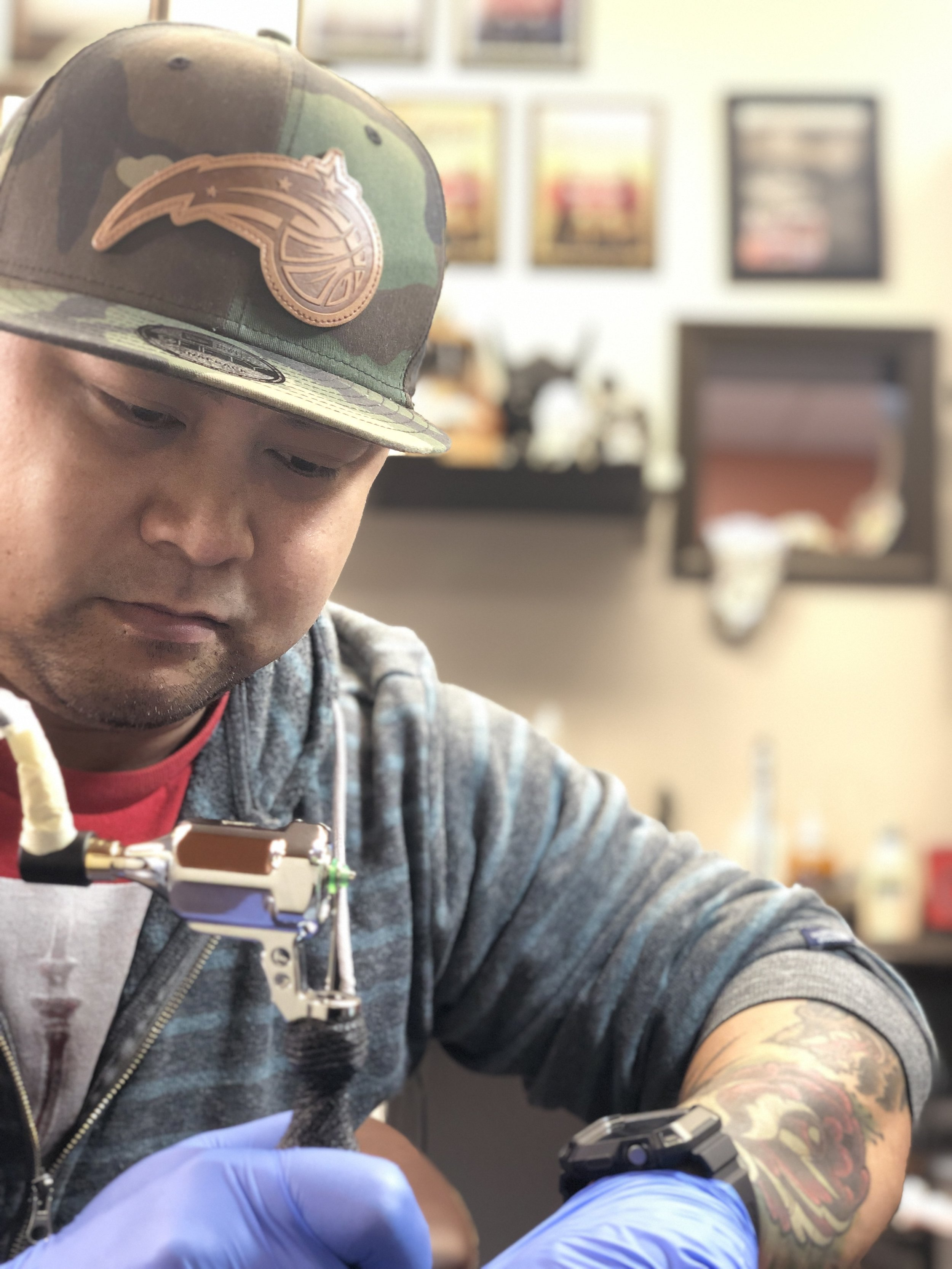 Jhed Guevara - Jhed is from Farmington Hills, Michigan. Born and raised in the Philippines, he came to the US in 2004. He has been tattooing for 6 years and considers himself a well rounded tattoo artist of any style. Jhed loves to tattoo fusions of different styles for example, color realism with a blackwork background. He also loves doing black & grey realism. Jhed has won several awards from the 2017 & 2018 Motor City Tattoo Expo in Detroit. Click his picture to check out his work.