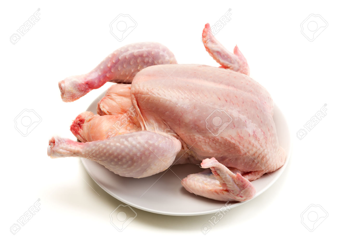 35307738-Carcass-of-broiler-chicken-on-a-plate-not-cooked-Isolate-on-white-background-Stock-Photo.jpg