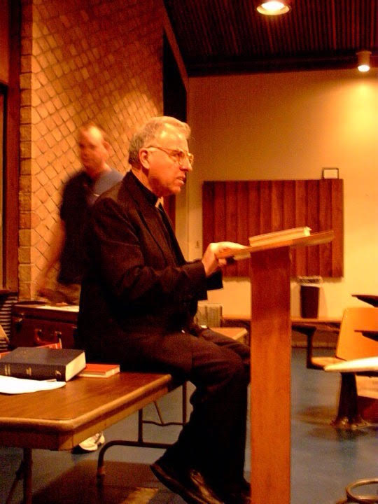 I snapped this pic of Dr. David Scaer lecturing as Seminarian (now Pastor) John Bennett strolls by in 2003.