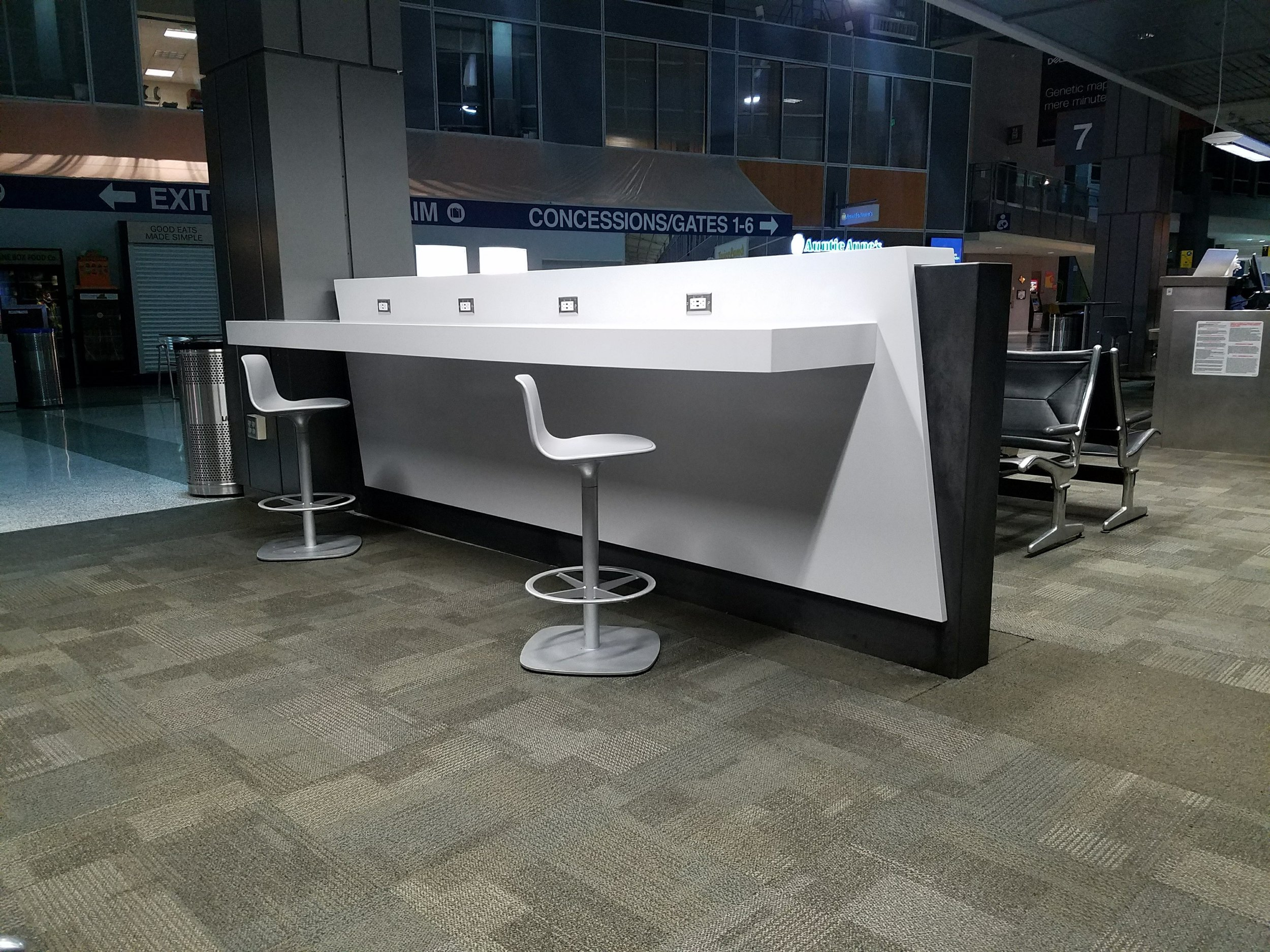 "Time to ""Plug In"" - Project Architect Gensler designed these free standing charging stations to give travelers a place to plug in. Sarabi Studio fabricated and installed the metals and support structure to assure long life and utility.They were installed in several locations in the existing terminal as well as the new concourse expansion."