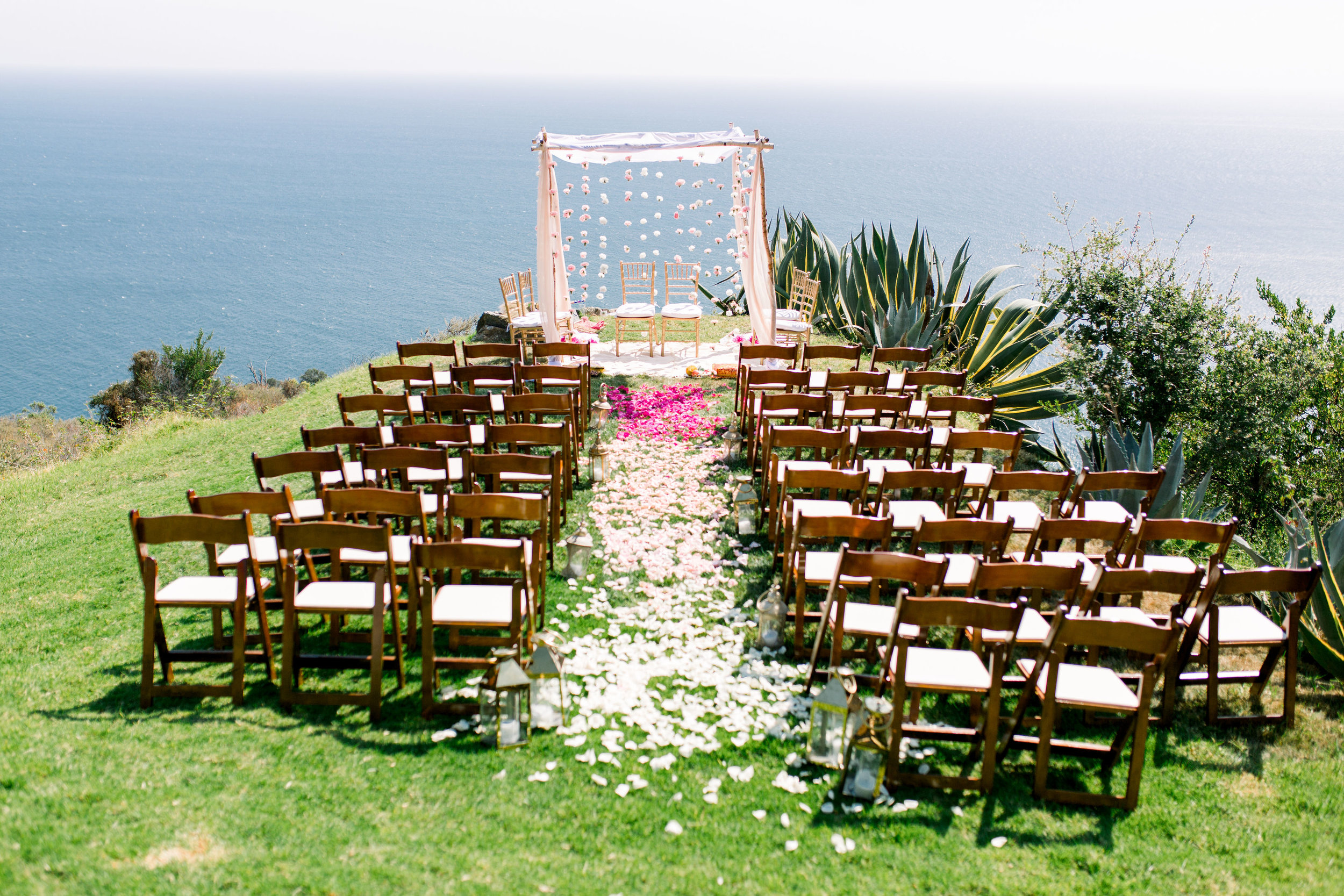 We are sure you understand how our jaws hit the floor when we saw this beautiful ceremony setup.